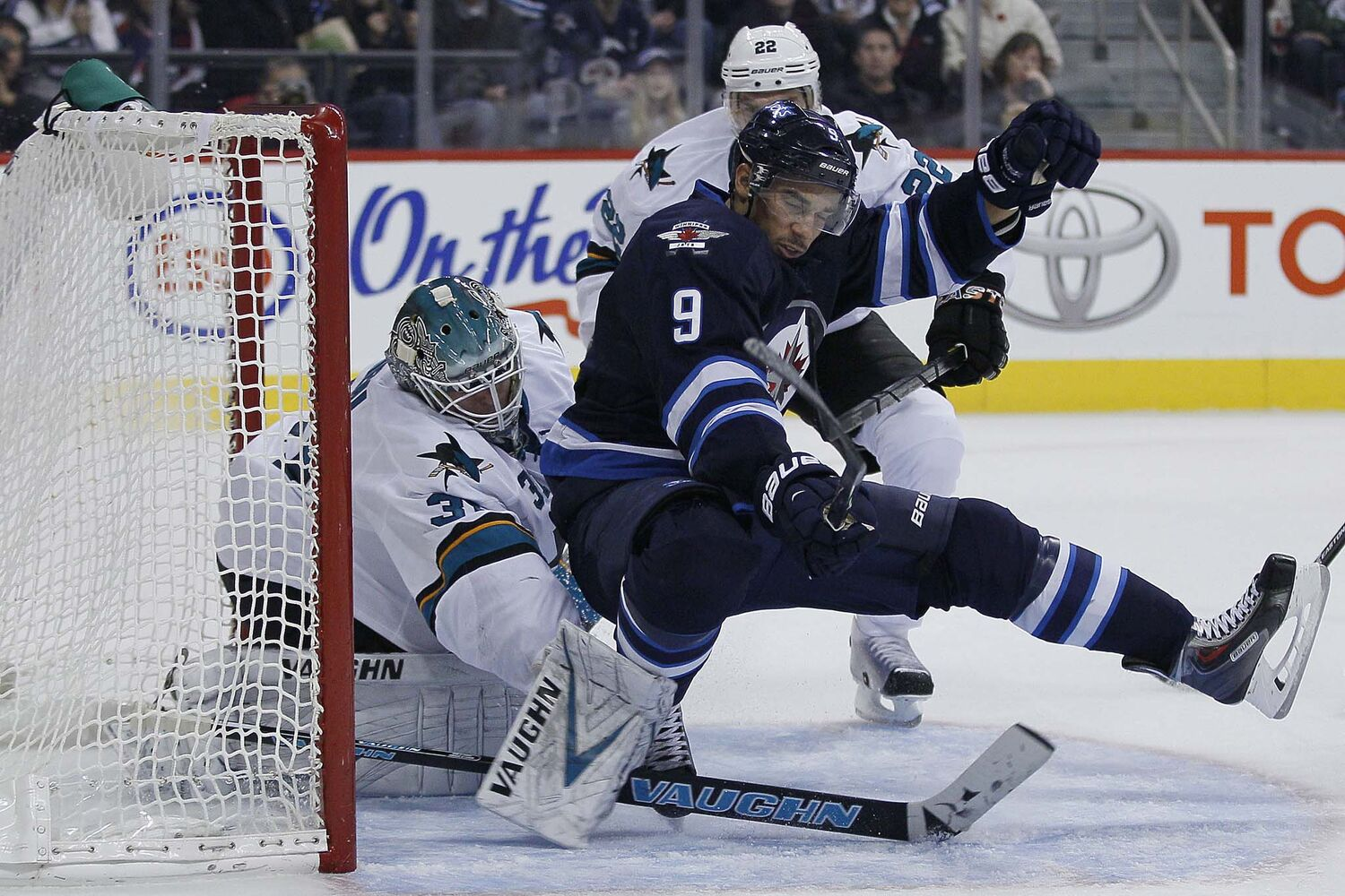 Winnipeg Jets' Evander Kane (9) crashes hard into San Jose Sharks' goaltender Antti Niemi (31) during second period action. (JOHN WOODS / WINNIPEG FREE PRESS)