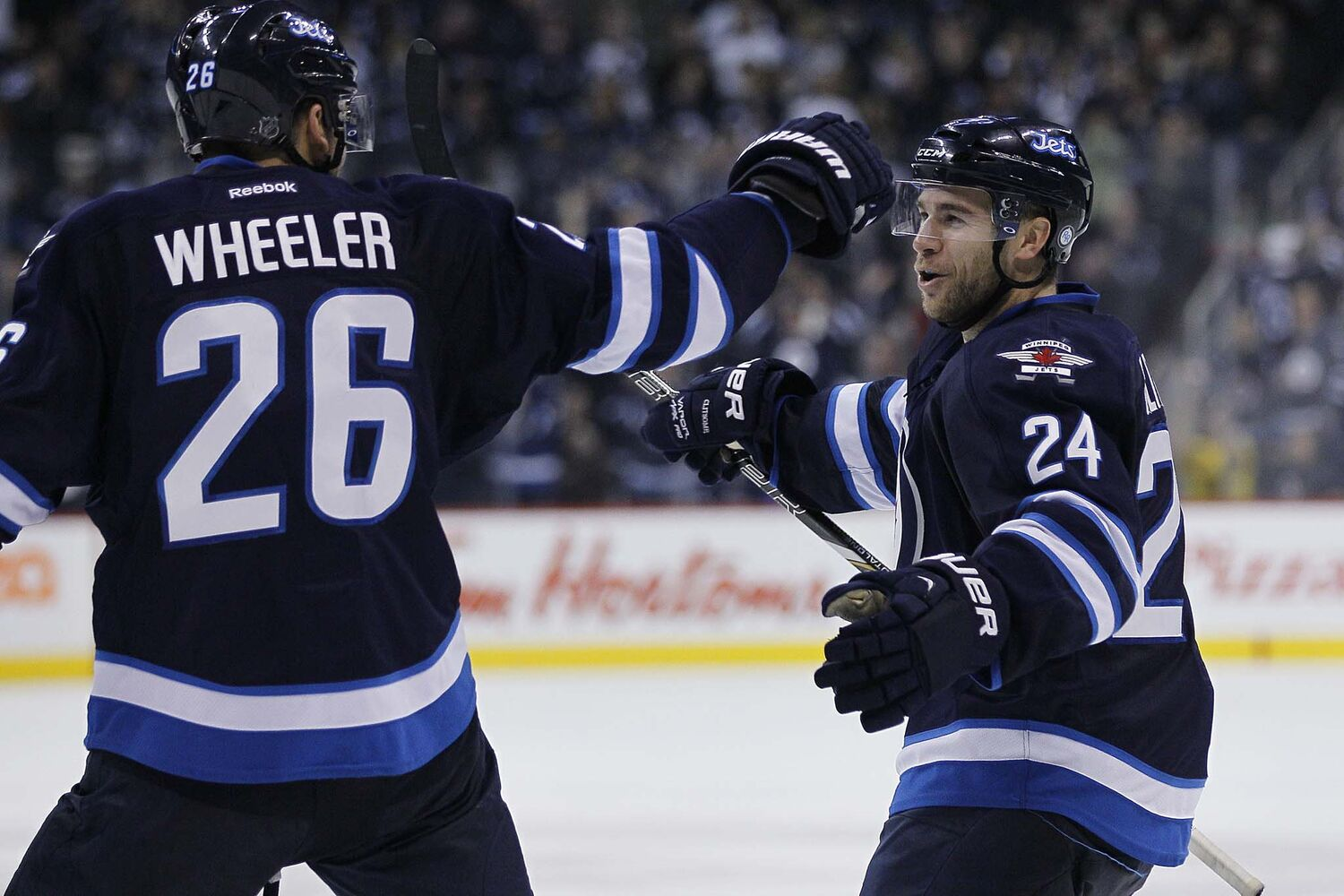 Winnipeg Jets' Grant Clitsome (24) and Blake Wheeler (26) celebrates Clitsome's goal against the San Jose Sharks during second period action. (JOHN WOODS / WINNIPEG FREE PRESS)