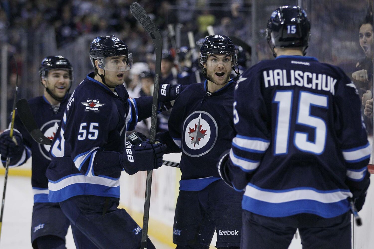 Winnipeg Jets' Michael Frolik (67), Grant Clitsome (24), Mark Scheifele (55) and Matt Halishchuk (15) celebrate Frolik's goal against San Jose Sharks' goaltender Antti Niemi (31) during second period action.