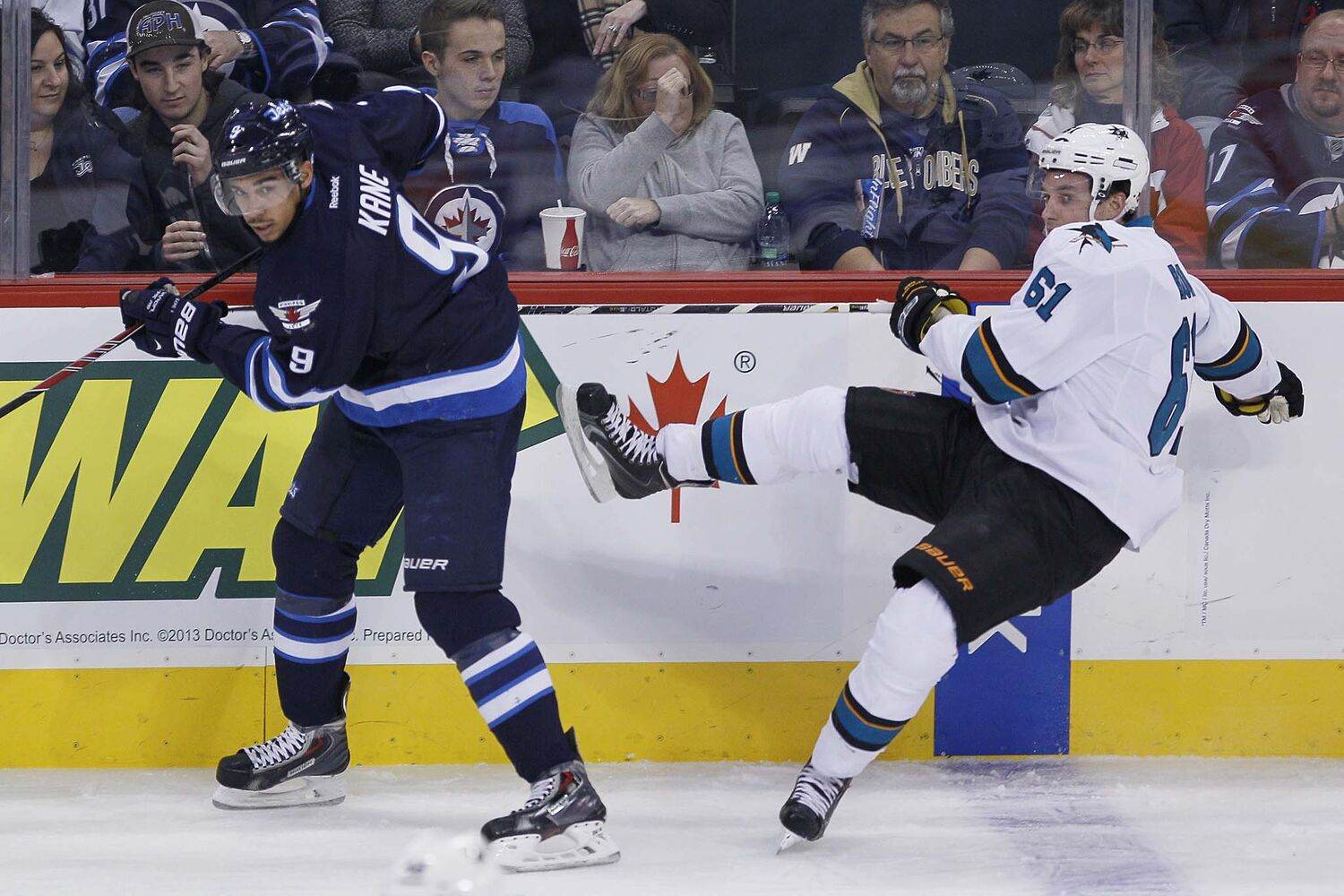 Winnipeg Jets' Evander Kane (9) checks San Jose Sharks' Justin Braun (61) during the first period. (JOHN WOODS / WINNIPEG FREE PRESS)