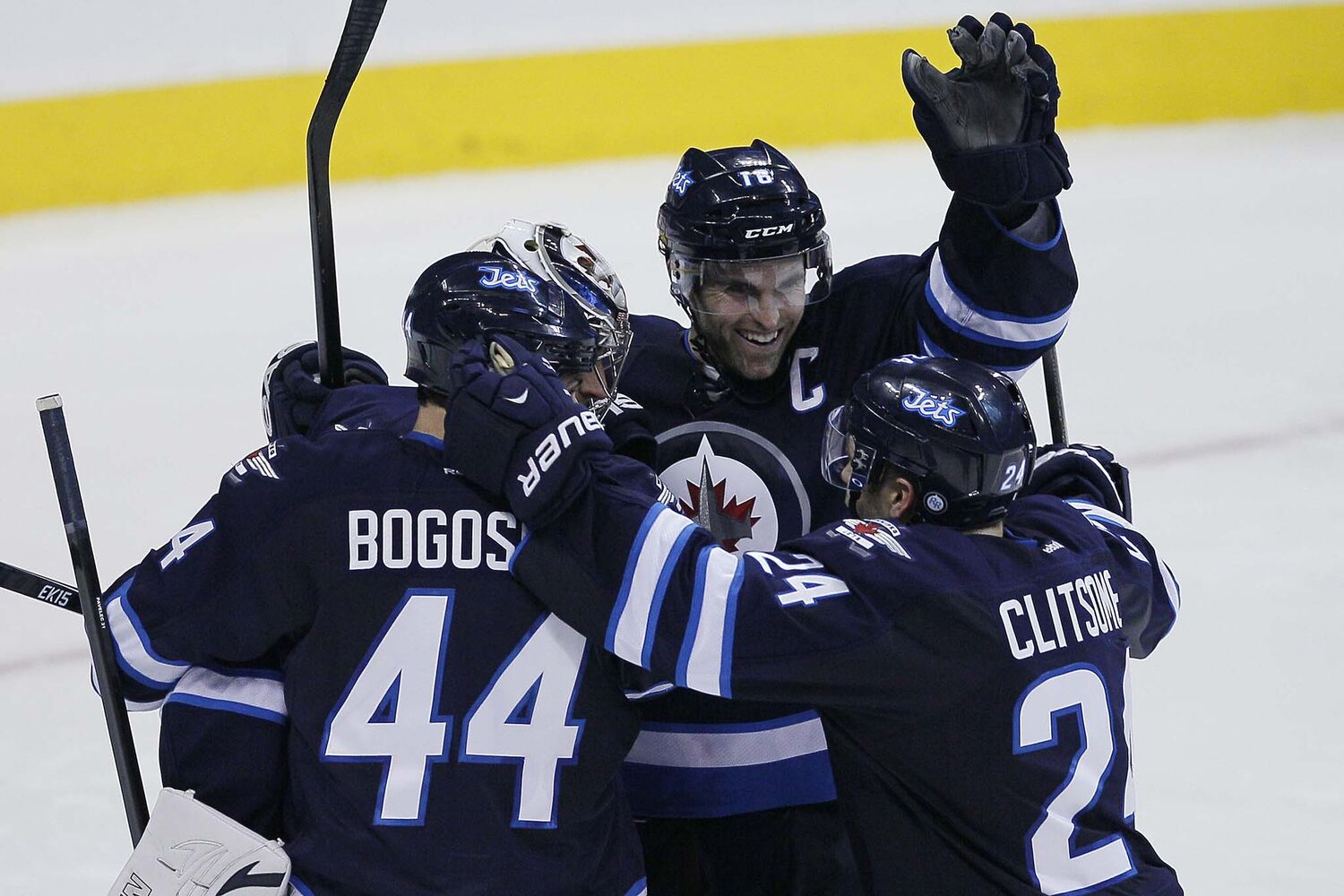 Winnipeg Jets' Zach Bogosian (44), goaltender Ondrej Pavelec (31), Andrew Ladd (16) and Grant Clitsome (24) celebrate their win over the over San Jose Sharks. (JOHN WOODS / WINNIPEG FREE PRESS)