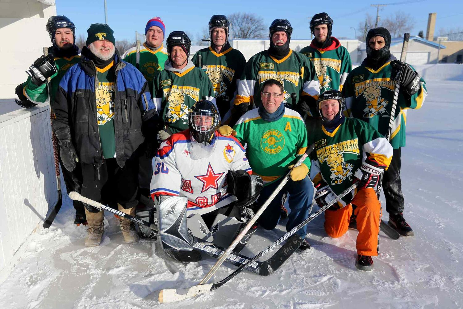 The Tumbleweeds, the oldest spongee team in the world, pose for a post-game photo. (Trevor Hagan / Winnipeg Free Press)