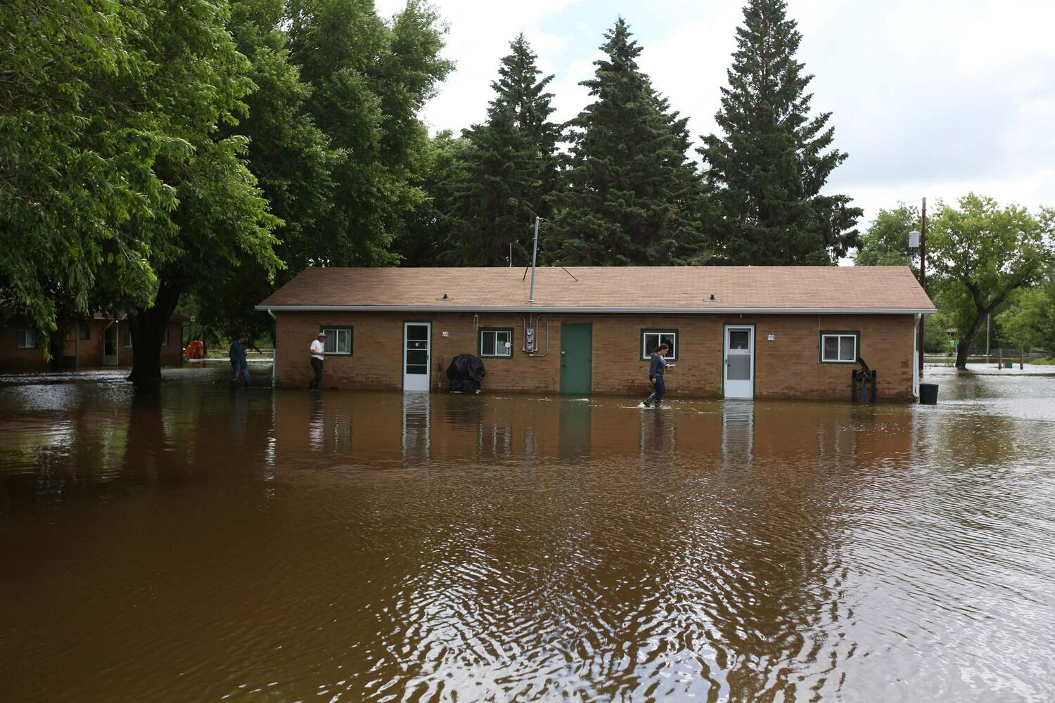 Apartments in Virden sit surrounded by water on Monday after the rising Gopher Creek inundated the building.