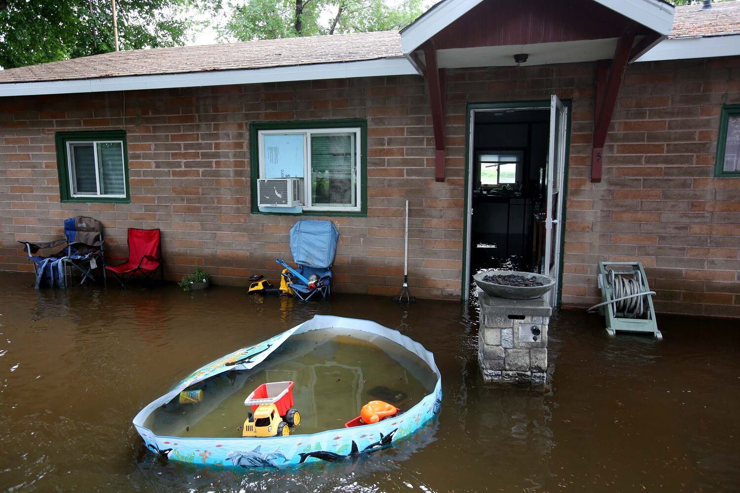 Apartments in Virden sit surrounded by water on Monday after the rising Gopher Creek inundated the homes over the weekend, forcing the evacuation of residents.  (Tim Smith / Brandon Sun)