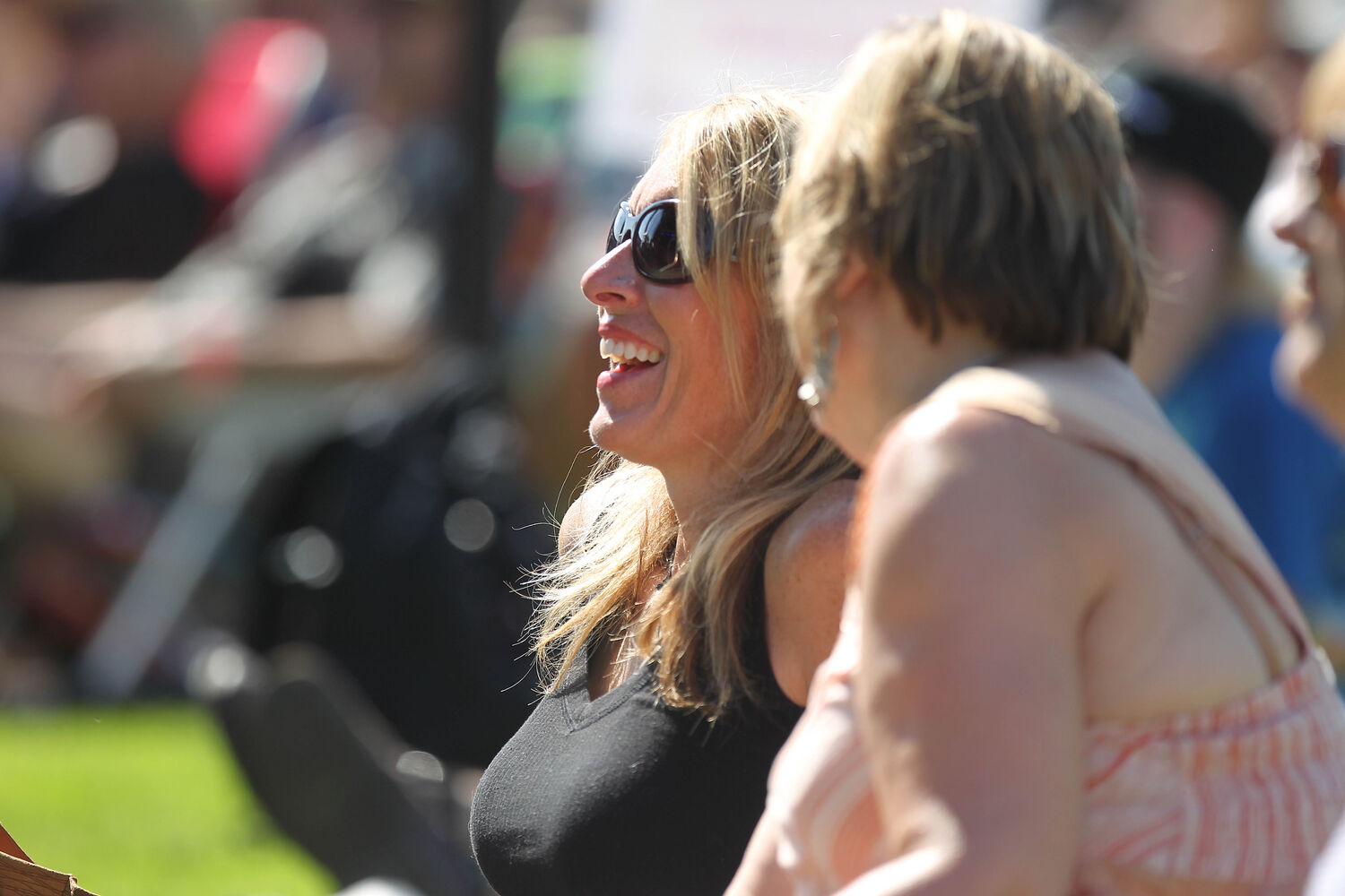 Jan Dumontet is all smiles as she listens to local band The Perpetrators at the Winnipeg BBQ & Blues Festival at Shaw Park Saturday.