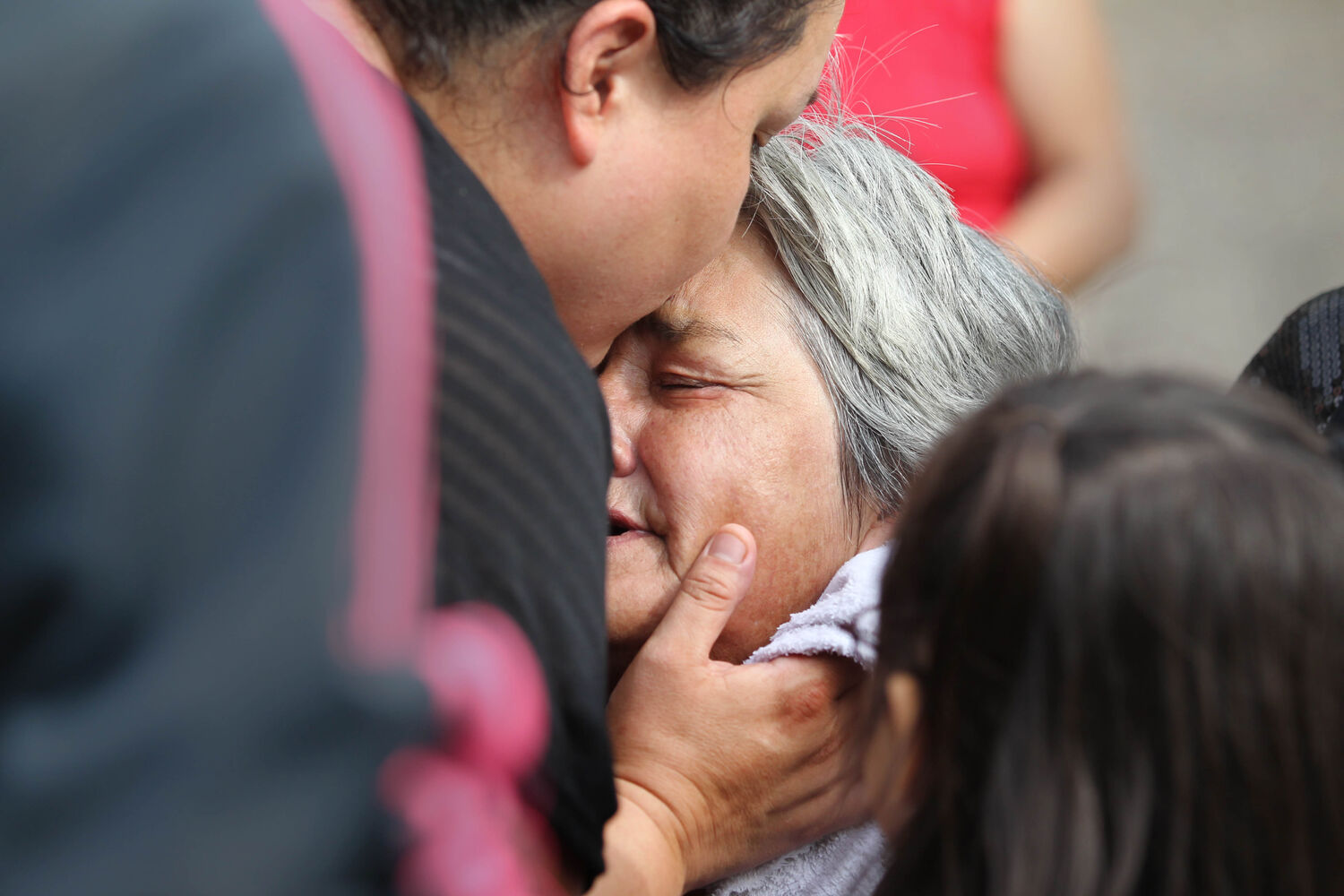 Thelma Favel broke down in tears and was comforted by her daughter Samatha Barto after her deceased grandniece, Tina Fontaine was taken away in a hearse at Sagkeeng First Nation following her funeral Saturday.   (Ruth Bonneville / The Winnipeg Free Press)