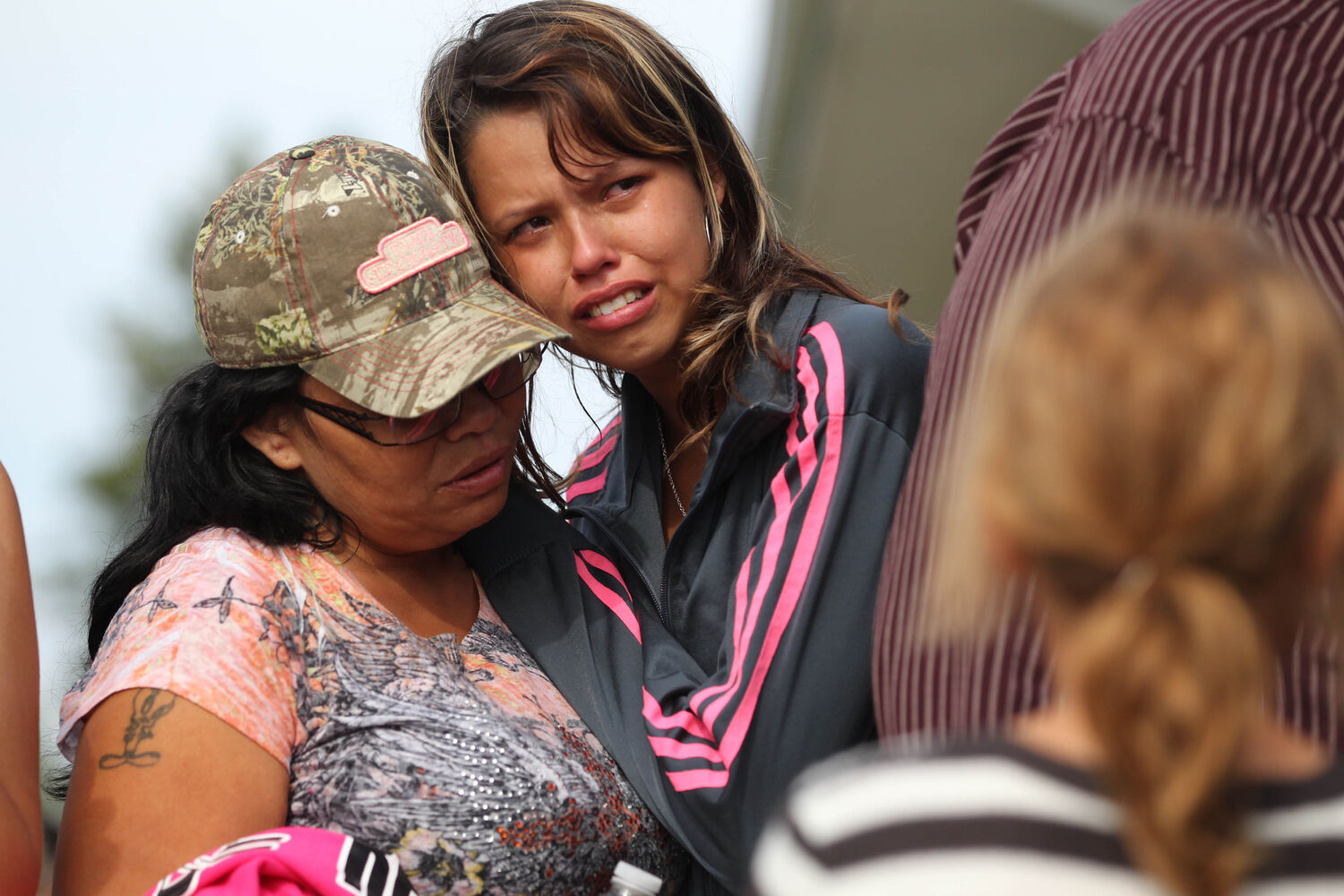Family members of Tina Fontaine break down into tears after her body is taken away in a hearse after her funeral in Sagkeeng First Nation Saturday. (Ruth Bonneville / The Winnipeg Free Press)
