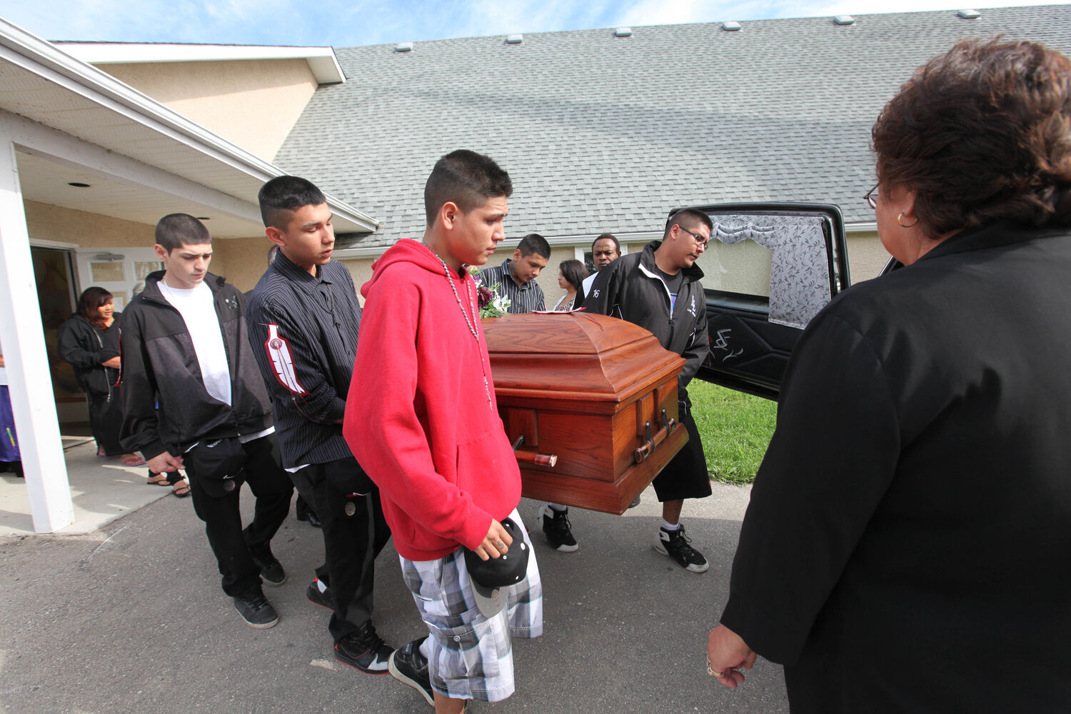 Pallbearers carry Tina Fontaine's casket outside the church Saturday her funeral in Sagkeeng First Nation.   (Ruth Bonneville / The Winnipeg Free Press)