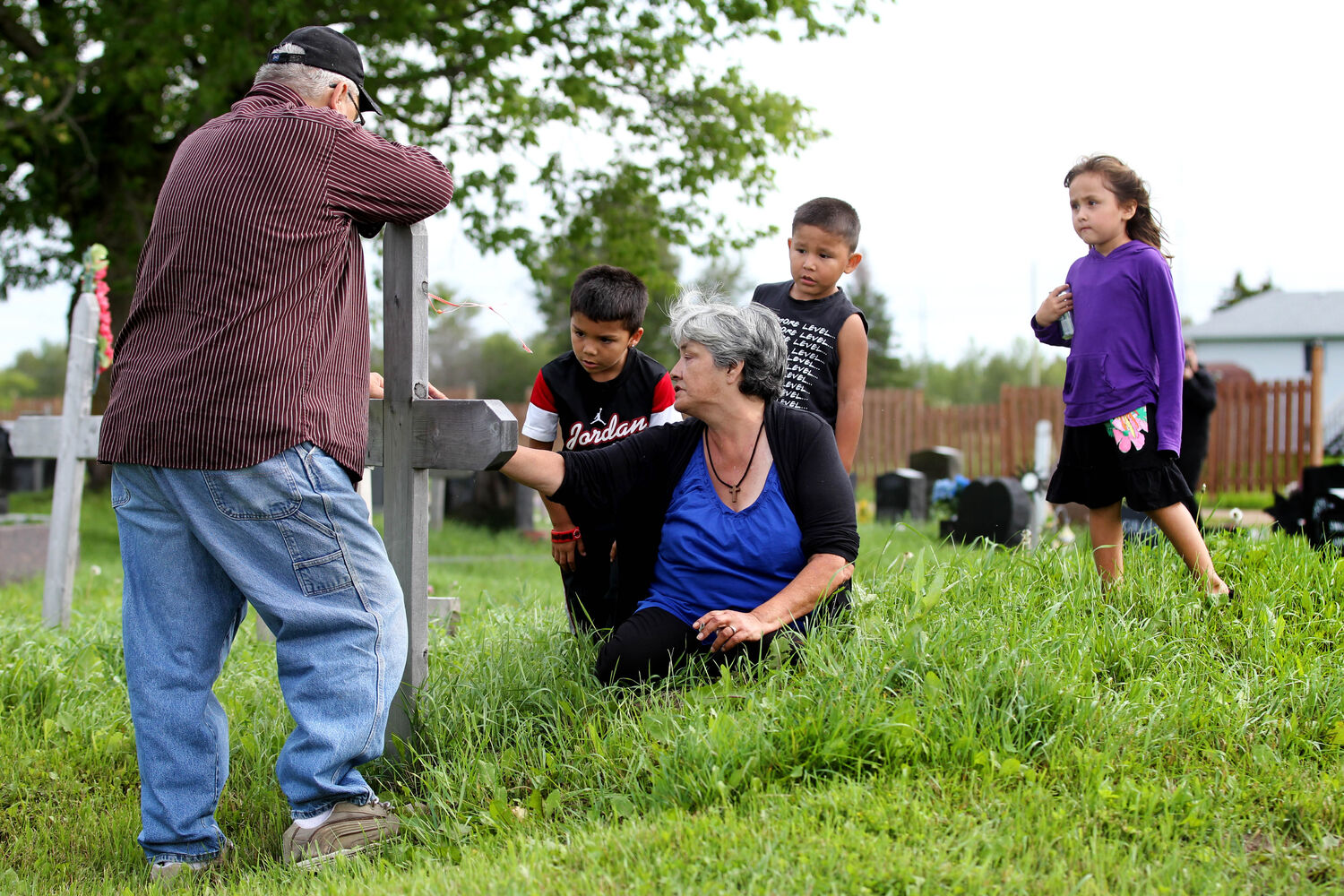 After the funeral for Tina Fontaine Saturday in Sagkeeng First Nation her grandmother, Thelma Favel, sat at the grave site of Tina's father, Eugene Robert Fontaine, the same site Tina Fontaine will be laid to rest in the coming days. Favel broke down into tears while begging her nephew's forgiveness for the death of Tina.  (Ruth Bonneville / The Winnipeg Free Press)