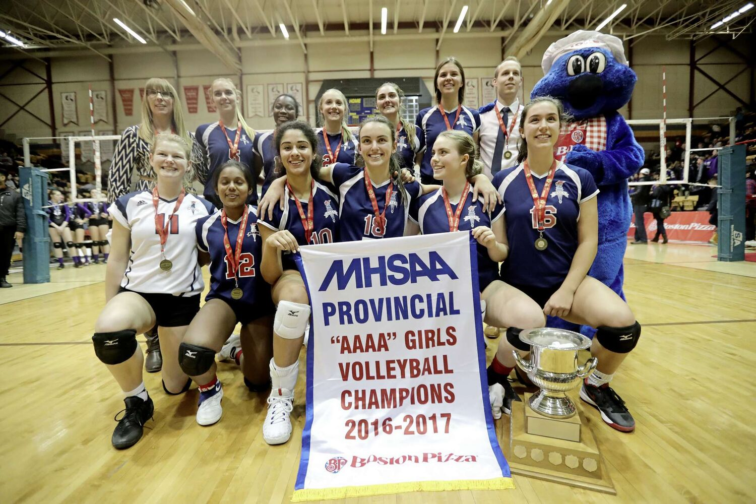 The St.Mary's Academy Flames celebrate their victory over Brandon's Vincent Massey Vikings in the AAAA varsity girls high school volleyball championship match at Investors Group Athletic Centre on Mon, Dec., 5. (TREVOR HAGAN / WINNIPEG FREE PRESS)