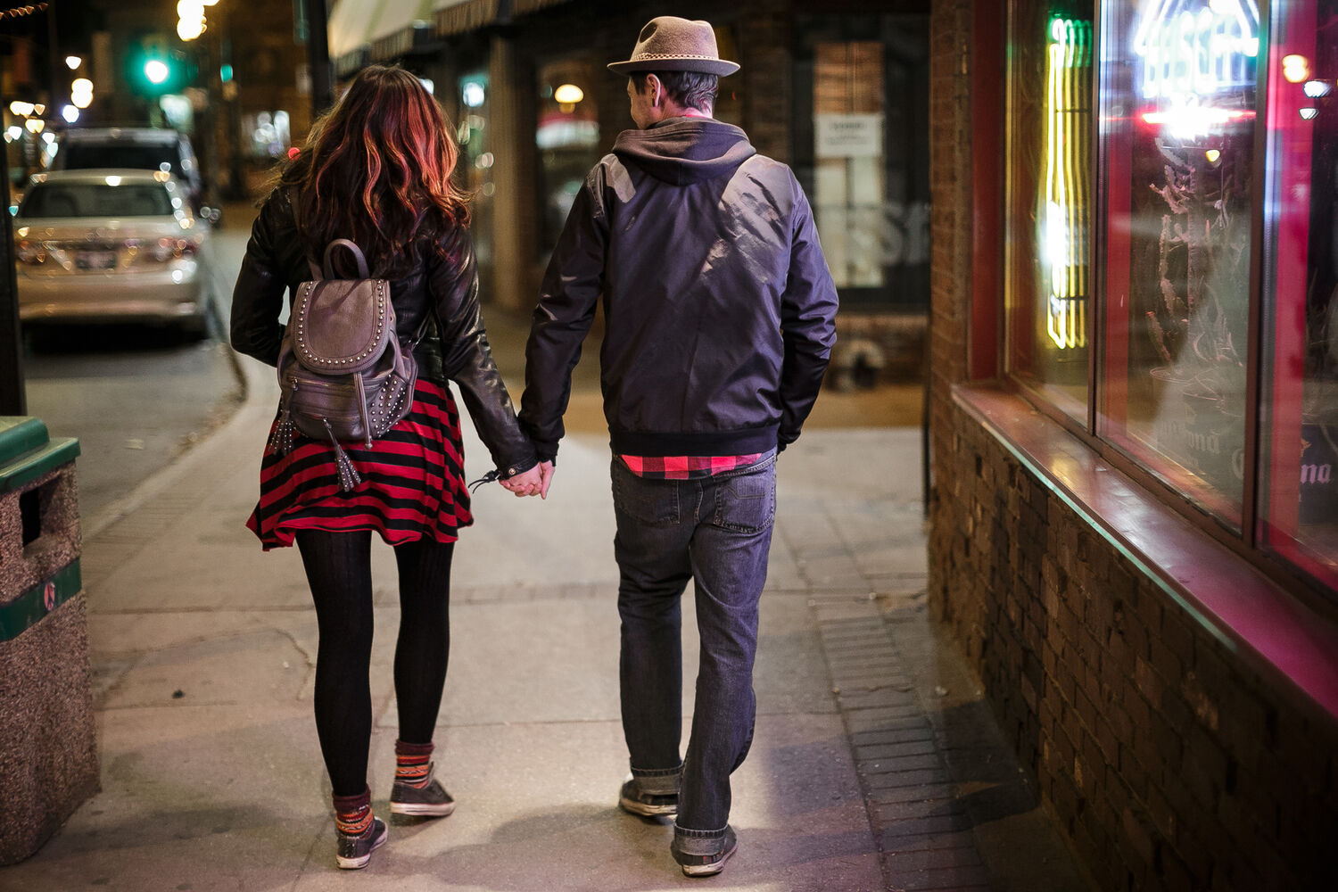 A good match. Doug and Hannah walk hand in hand down a neon Osborne Street. Day 10. (MELISSA TAIT / WINNIPEG FREE PRESS)
