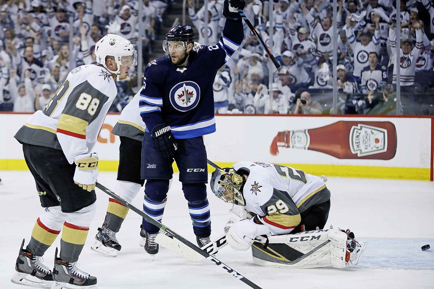 JOHN WOODS / THE CANADIAN PRESS</p><p>Winnipeg Jets' Paul Stastny (25) celebrates Mark Scheifele's (not shown) goal on Vegas Golden Knights goaltender Marc-Andre Fleury (29) as Nate Schmidt (88) defends during second period of game one action in the NHL Western Conference Final in Winnipeg on Saturday, May 12, 2018.</p>