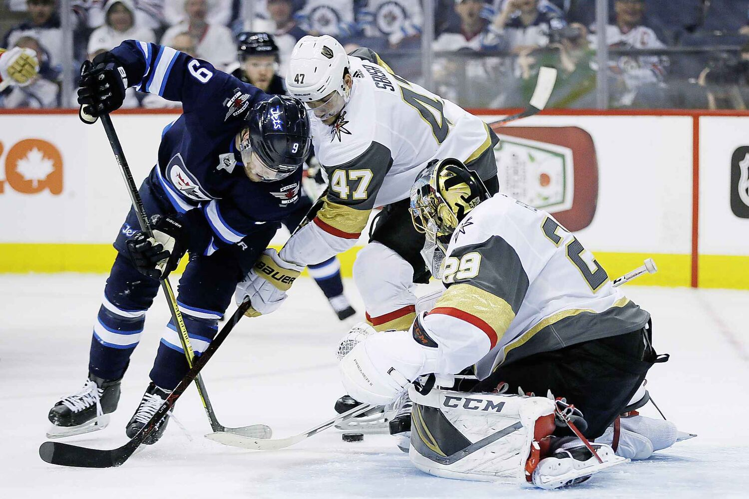 JOHN WOODS / THE CANADIAN PRESS</p><p>Vegas Golden Knights' goaltender Marc-Andre Fleury (29) knocks the puck away from Winnipeg Jets' Andrew Copp (9) as Knights' Luca Sbisa (47) defends during second period of game one action in the NHL Western Conference Final in Winnipeg on Saturday, May 12, 2018.</p>