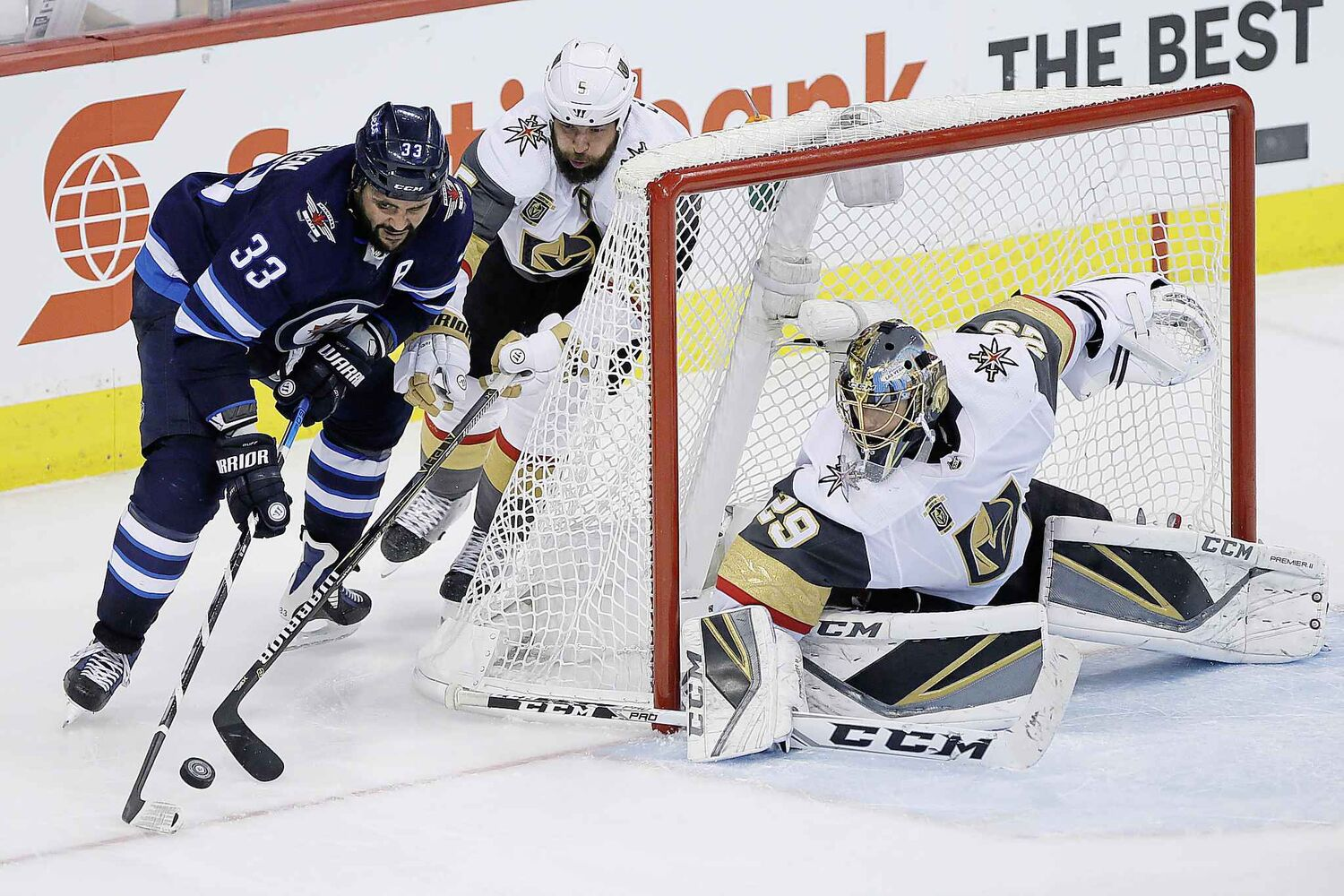 JOHN WOODS / THE CANADIAN PRESS</p><pWinnipeg Jets' Dustin Byfuglien (33) attempts the wraparound on Vegas Golden Knights� Deryk Engelland (5) and goaltender Marc-Andre Fleury (29) during third period of game one action in the NHL Western Conference Final in Winnipeg on Saturday, May 12, 2018.</p>