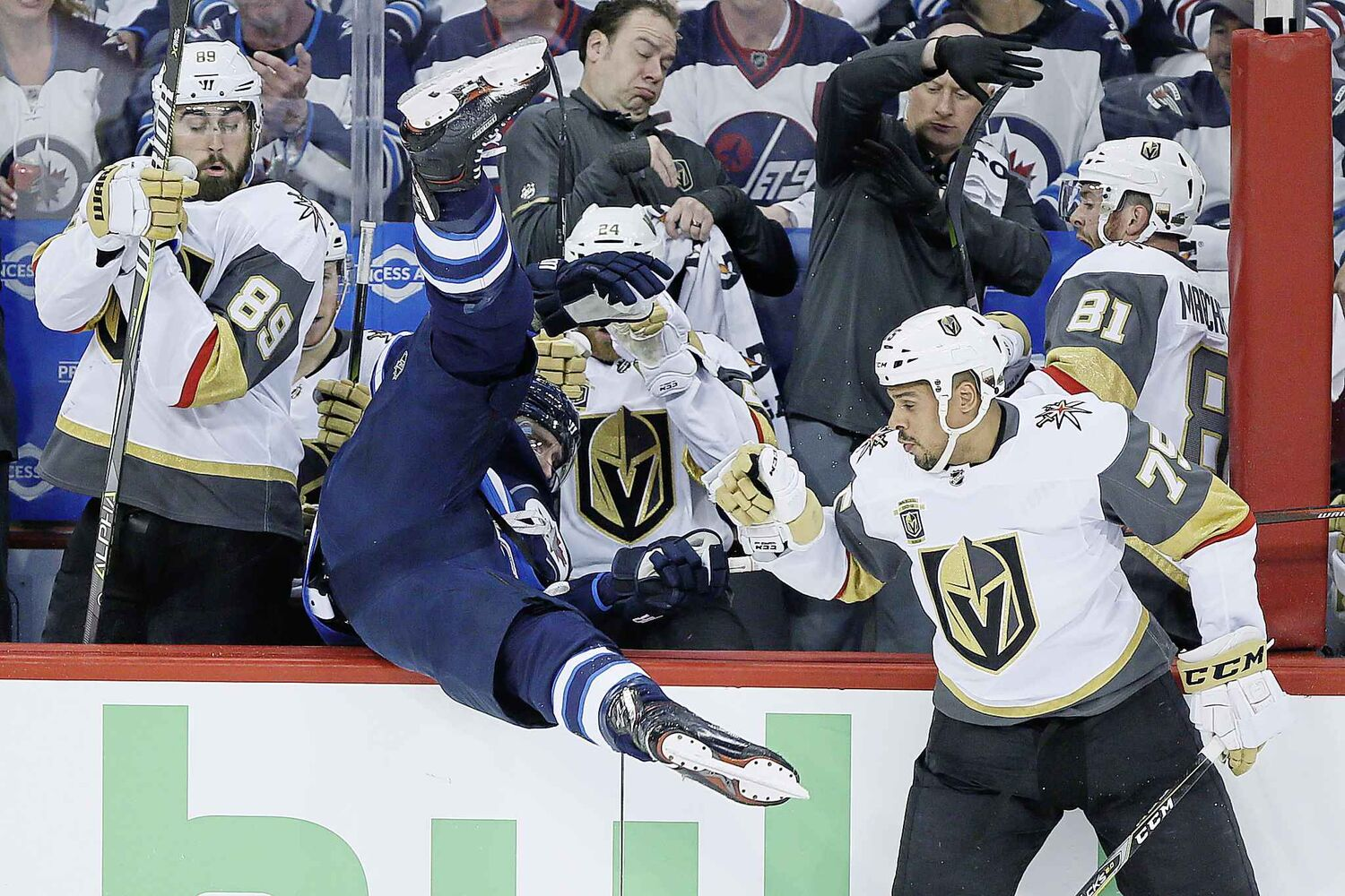 JOHN WOODS / THE CANADIAN PRESS</p><p>Winnipeg Jets' Blake Wheeler (26) gets dumped over the Vegas boards by Vegas Golden KnightsÕ Ryan Reaves (75) during first period of game one action in the NHL Western Conference Final in Winnipeg on Saturday, May 12, 2018.</p>