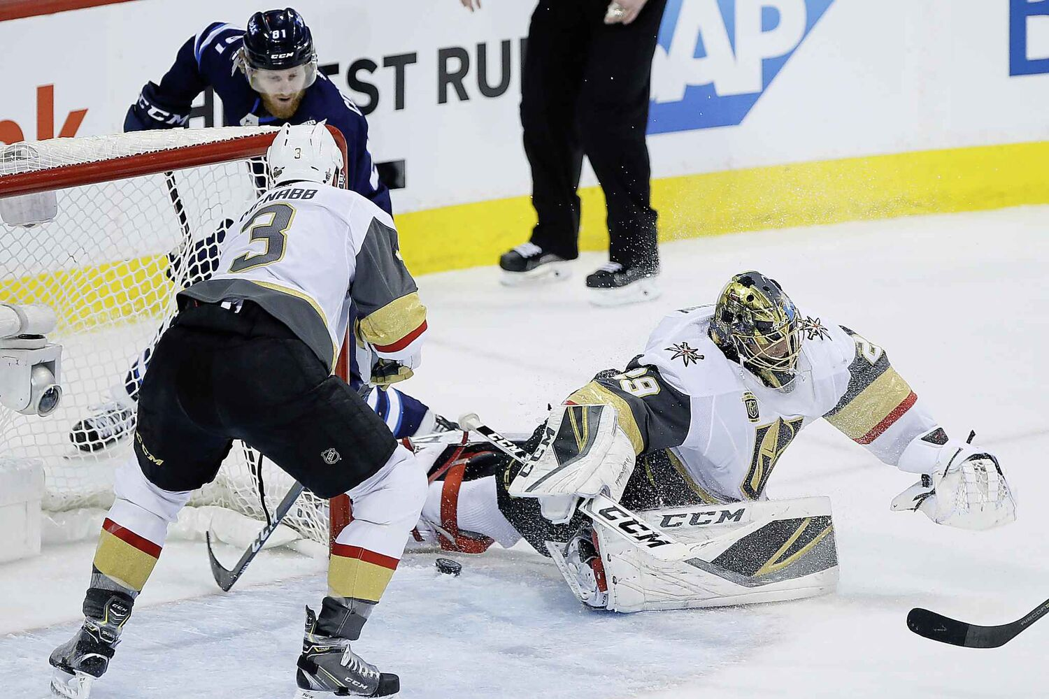JOHN WOODS / THE CANADIAN PRESS</p><p>Winnipeg Jets' Kyle Connor (81) shot goes through the pads of Vegas Golden Knights goaltender Marc-Andre Fleury (29) but Brayden McNabb (3) clears it during first period of game one action in the NHL Western Conference Final in Winnipeg on Saturday, May 12, 2018.</p>