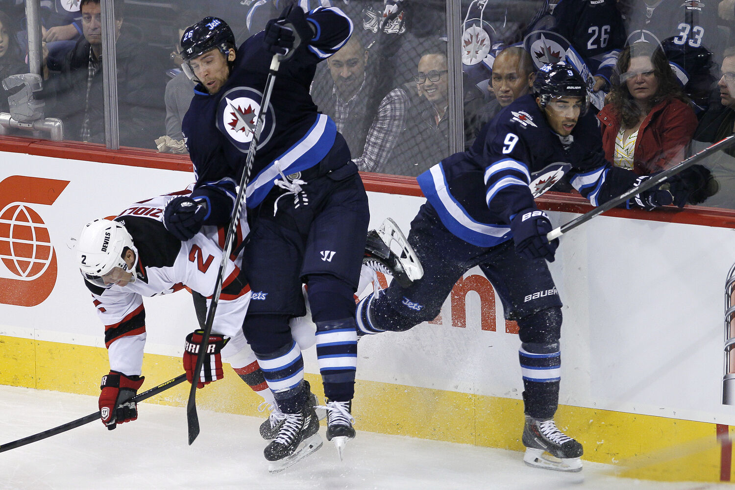Blake Wheeler and Evander Kane collide with Marek Zidlicky during the first period.