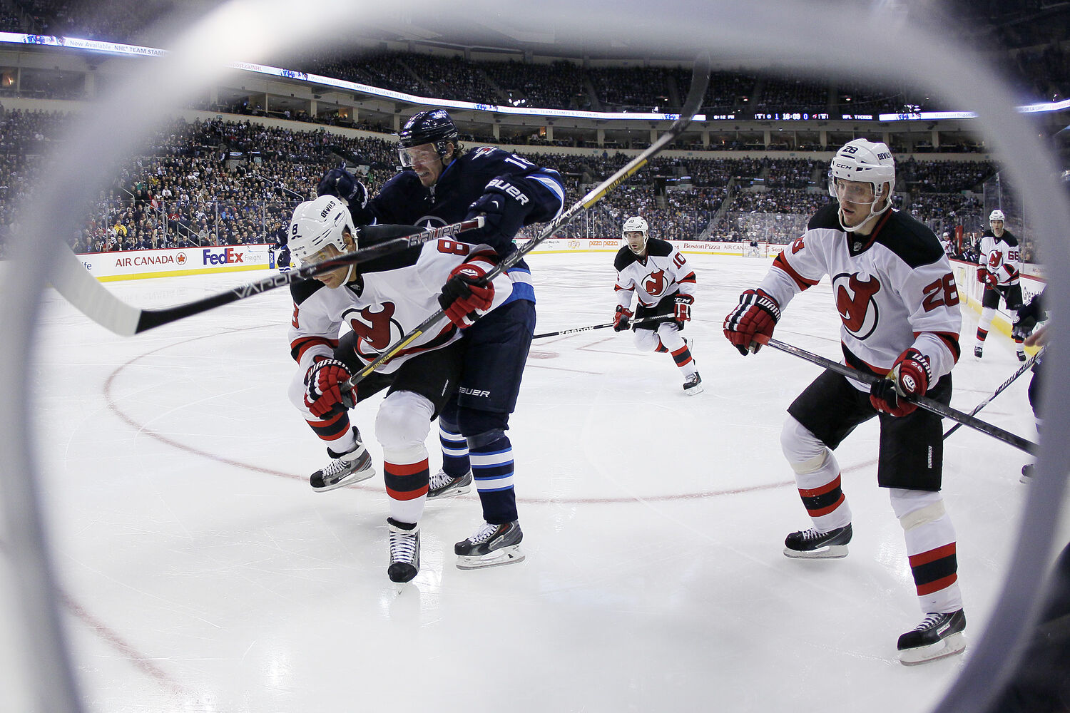 Bryan Little drives for the corner against Dainius Zubrus during the second period. (WINNIPEG FREE PRESS)