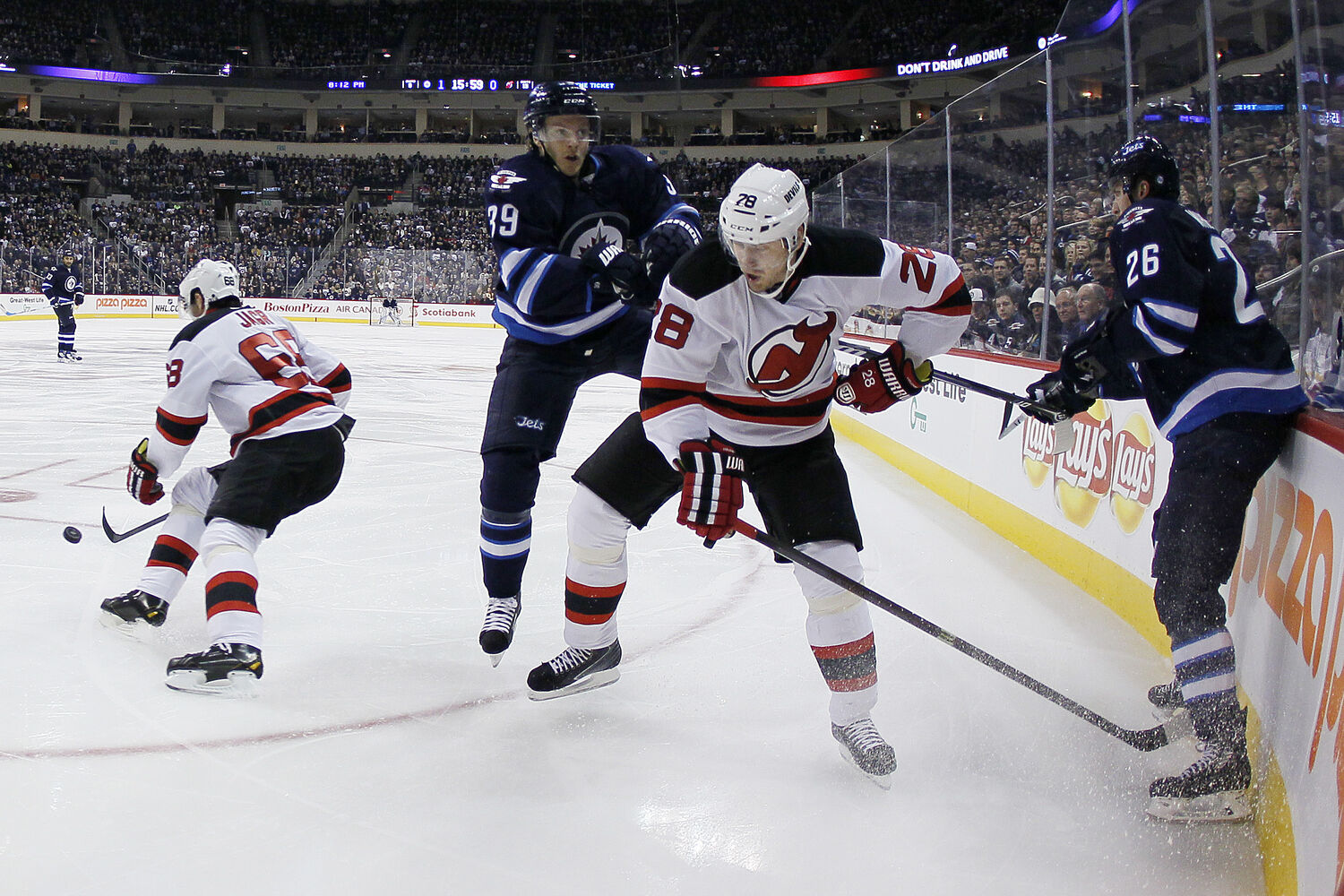 Toby Enstrom attempts to go around Anton Volchenkov during the second period. (JOHN WOODS / WINNIPEG FREE PRESS)
