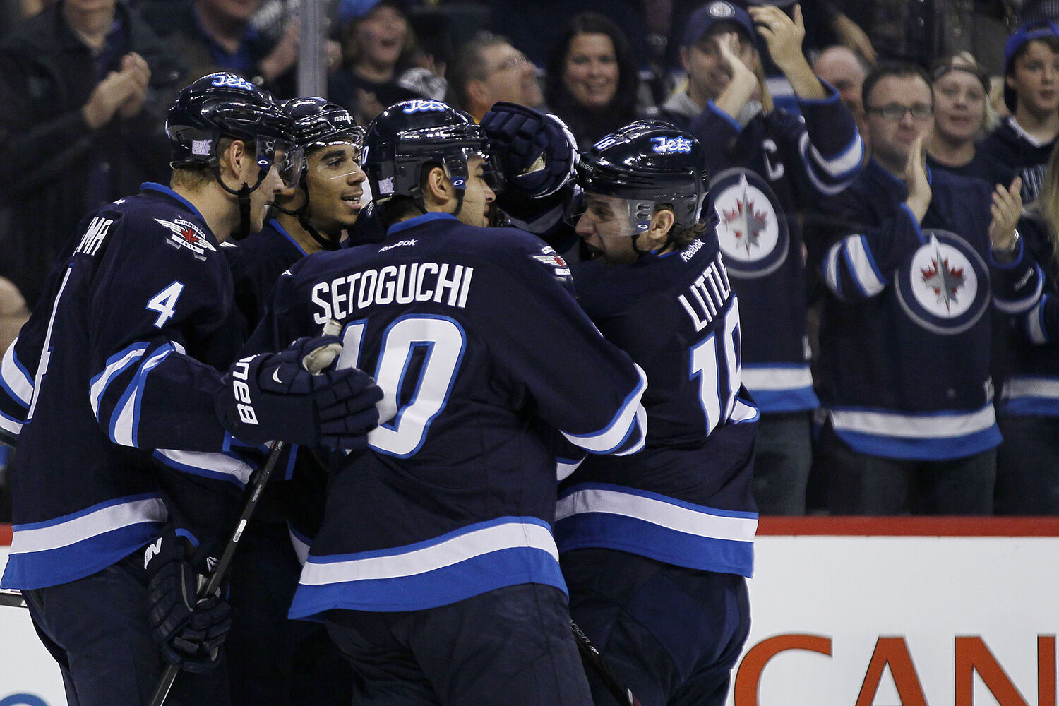 Paul Postma, Evander Kane, Devin Setoguchi and Bryan Little celebrate Kane's goal.