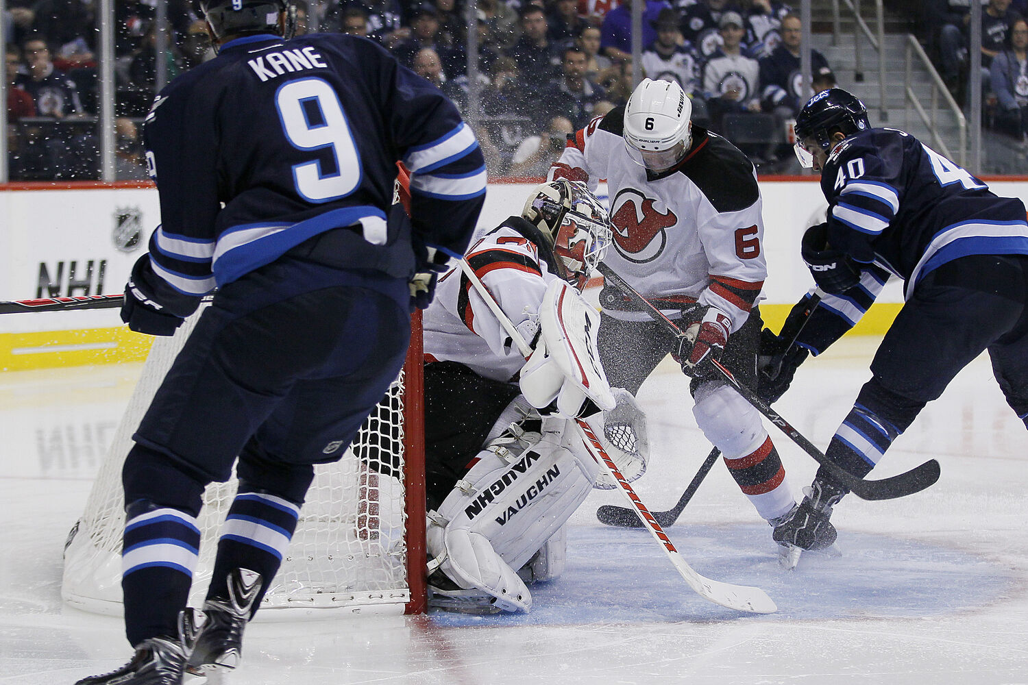 Evander Kane's shot deflects off New Jersey Devils' Andy Greene and past goaltender Cory Schneider for the Jets first goal during the second period. (JOHN WOODS / WINNIPEG FREE PRESS)