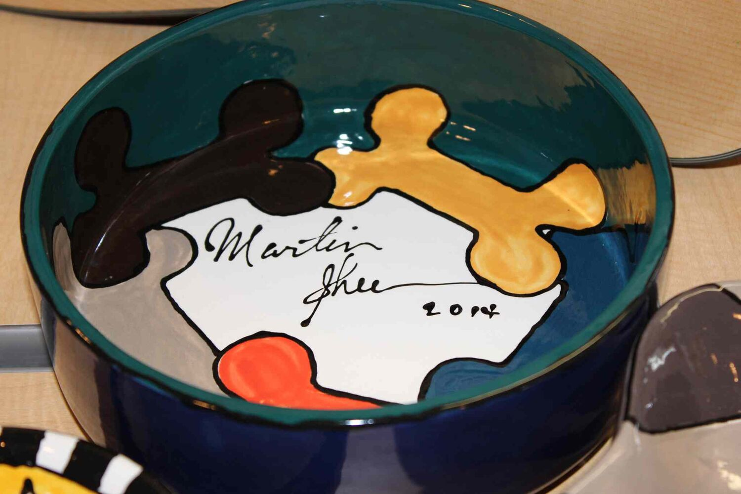 WHS ceramic pet bowl signed by Martin Sheen.  (Steph Crosier)
