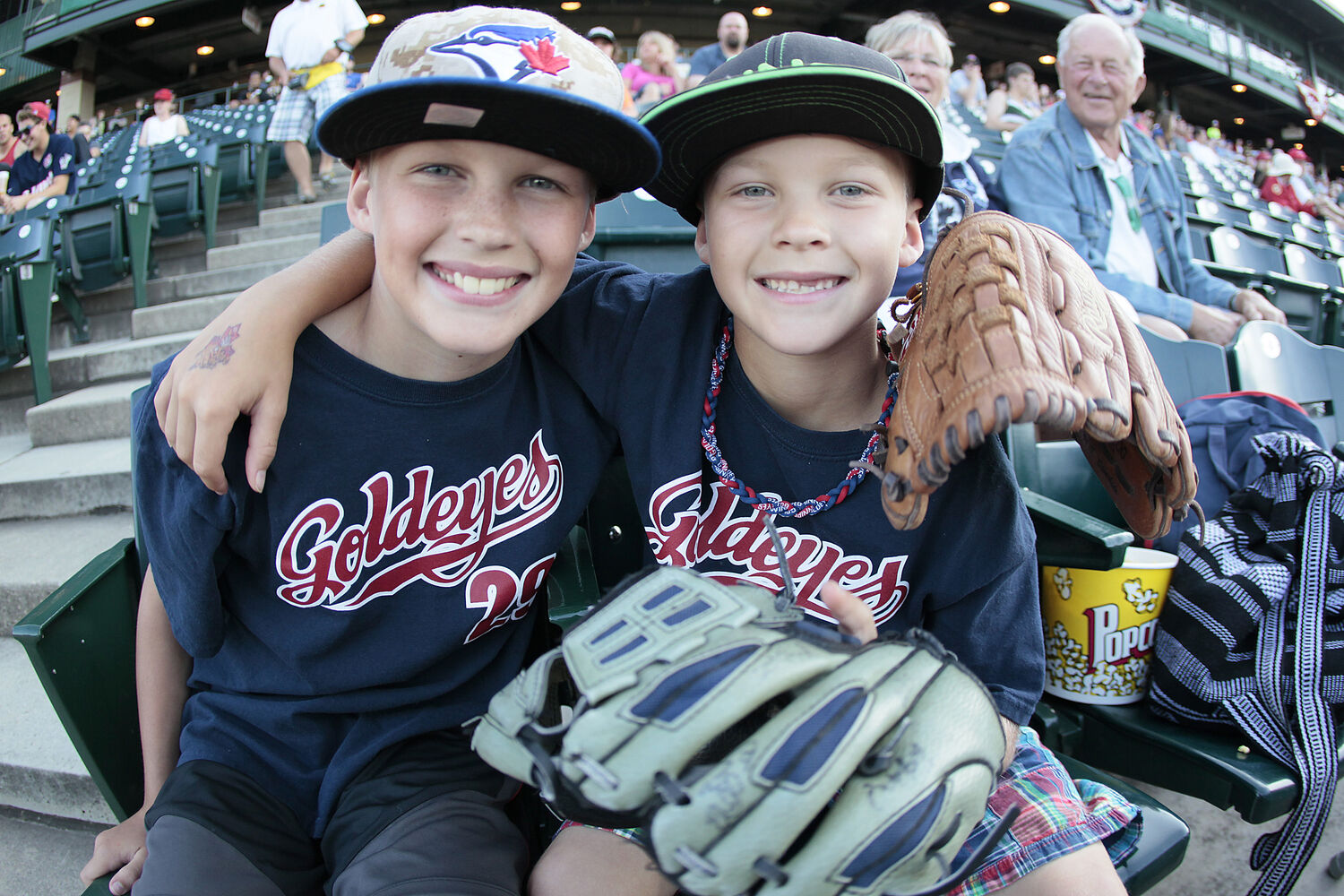 Brothers Matthew and Nathan Brown hang out at Shaw Park during Monday's festivities. (John Woods / WInnipeg Free Press)