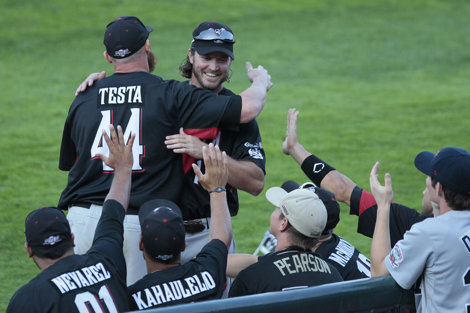 Carlo Testa of the Wichita Wingnuts is congratulated by his team for winning the title of Fastest Baserunner at the All-Star Skills Competition in Winnipeg Monday. (John Woods / WInnipeg Free Press)