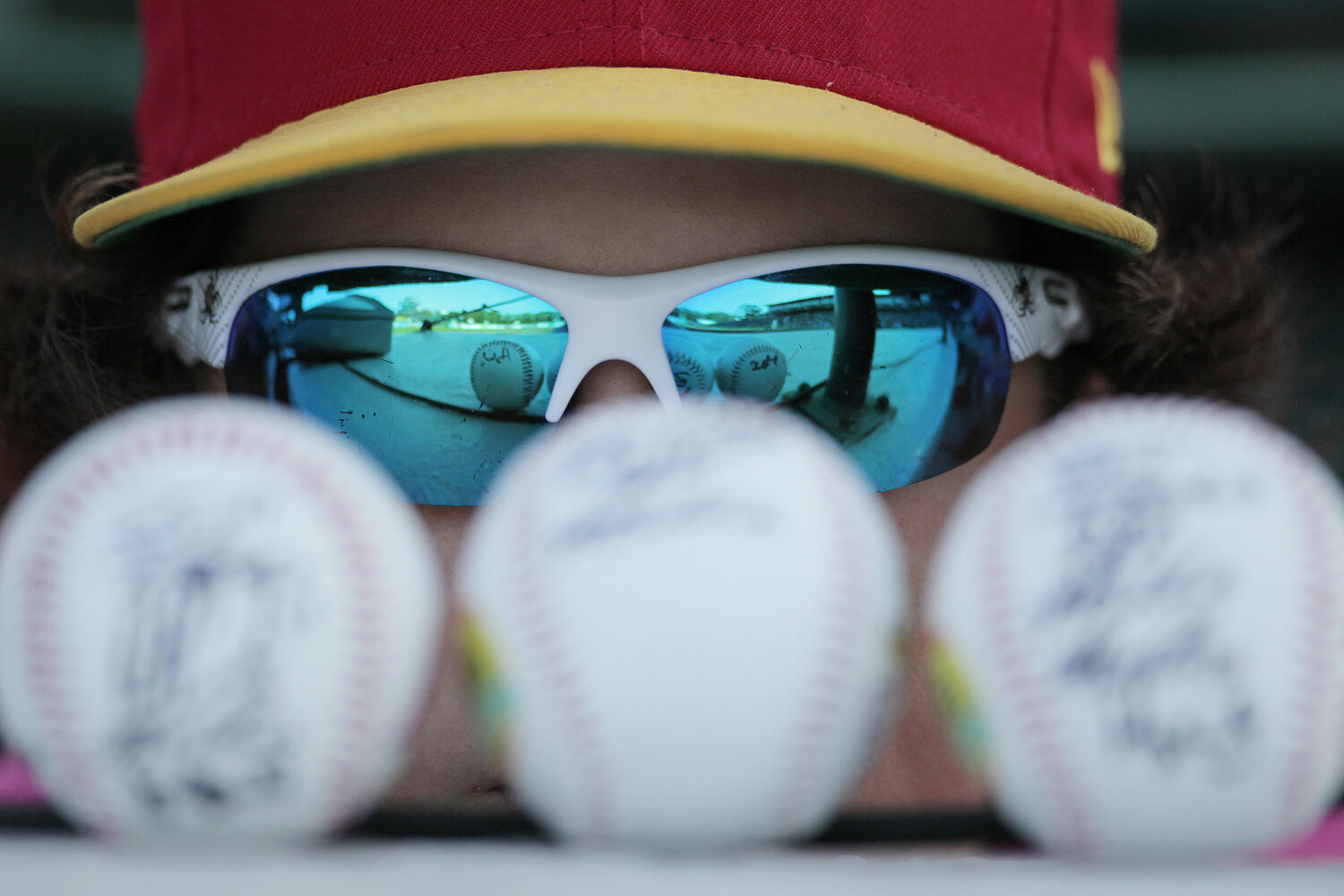 Reegan Warren, 12, shows off his signed baseballs at the All-Star Skills Competition in Winnipeg Monday.
