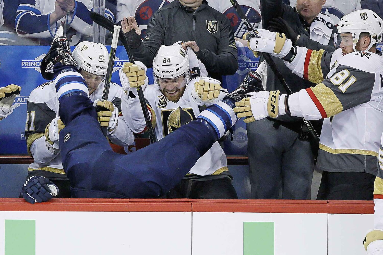JOHN WOODS / THE CANADIAN PRESS</p><p>Winnipeg Jets' Blake Wheeler (26) gets dumped over the Vegas boards by Vegas Golden Knights' Ryan Reaves (75) in front of Cody Eakin (21), Oscar Lindberg (24) and Jonathan Marchessault (81) during first period of game one action in the NHL Western Conference Final in Winnipeg on Saturday, May 12, 2018.</p> (CP)