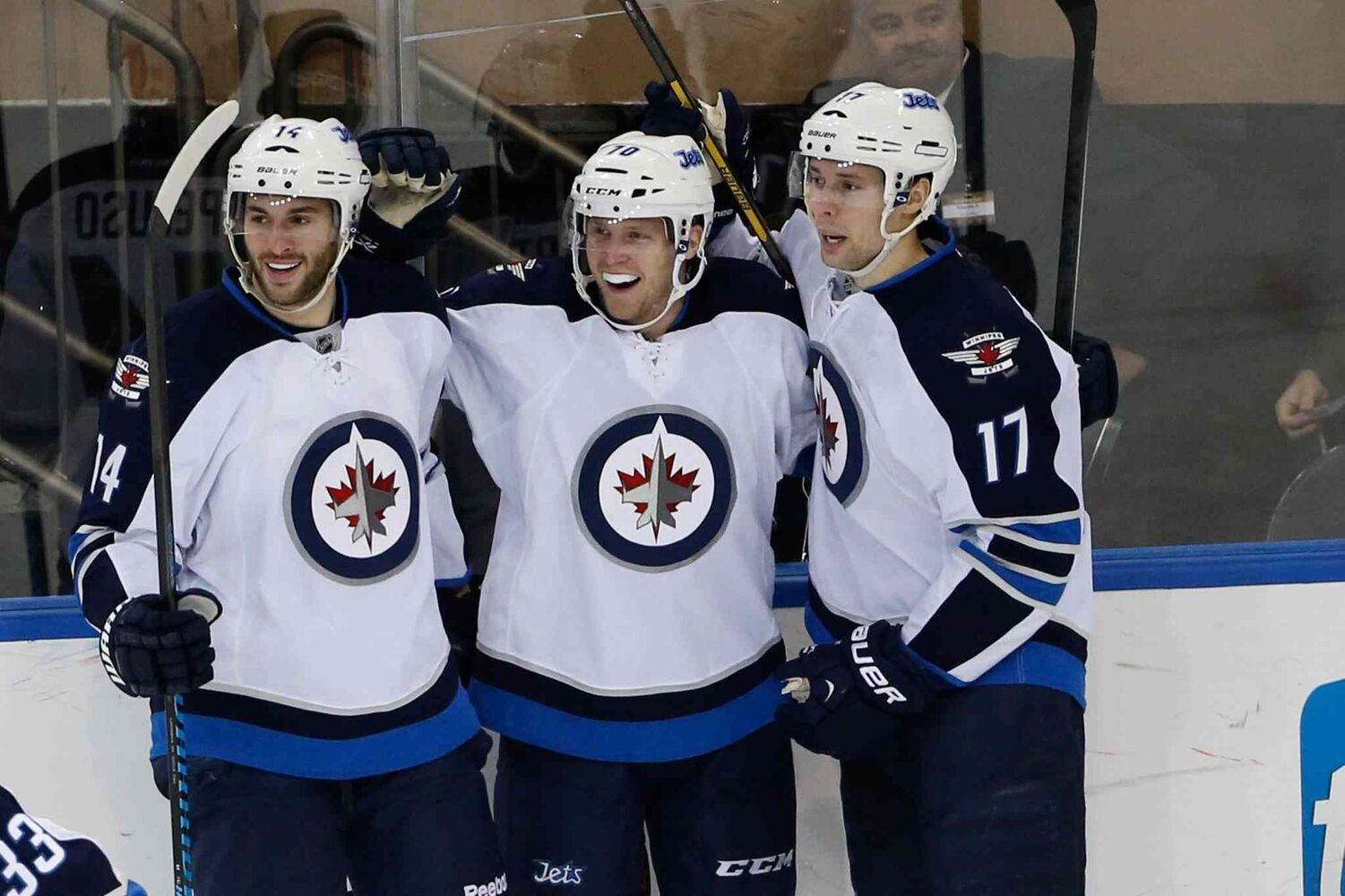 Winnipeg Jets forward John Albert (centre) celebrates his goal with teammates Anthony Peluos (left) and James Wright during the second period. (Anthony Gruppuso / USA Today Sports)