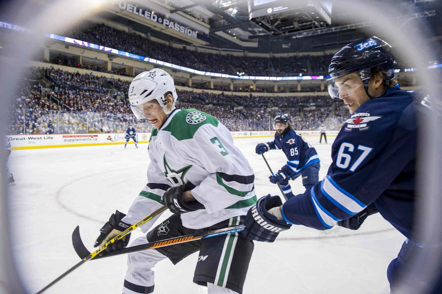 Winnipeg Jets Michael Frolik (#67) collides with Dallas Stars John Klingberg (#3) during second period. (David Lipnowski / Winnipeg Free Press)