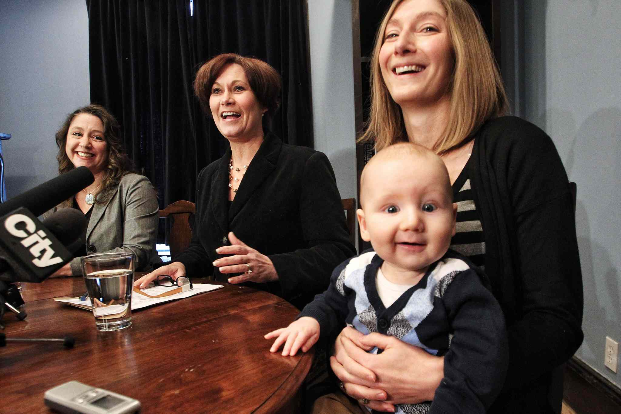 NDP leadership hopeful Theresa Oswald plans to hire more midwives and establish a breast-milk bank. Tracey Novoselnik of the Midwifery Association of Manitoba (left) and Katie Findlater, with son, Liam, attended the event to show their support.