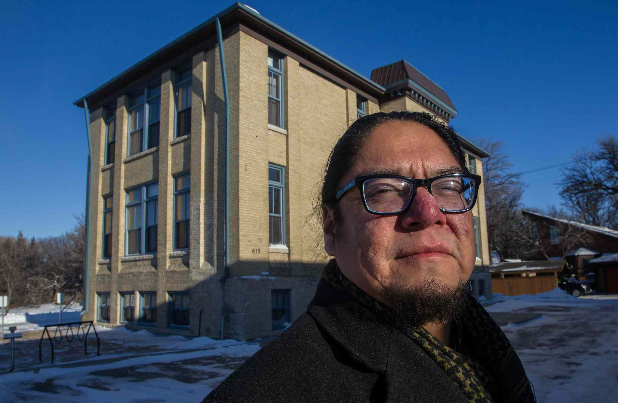 Maeengan Linklater, in front of the former site of the Assiniboine Residential School, formally recognized as one of Canada's Historic Places, not for being a residential school but for its role as the Julia Clark School, which featured prominantly in the early development of the city's child welfare system. It is now houses the Canadian Centre for Child Protection.
