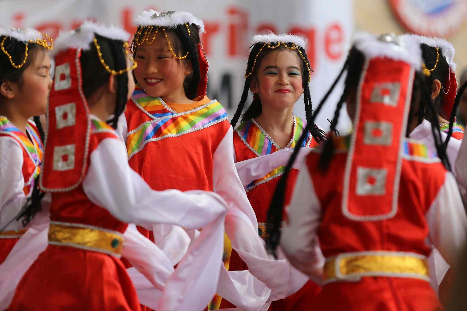 Members of the Great Wall Performing Arts school perform during Asian Heritage Month celebrations at The Forks, Sunday.