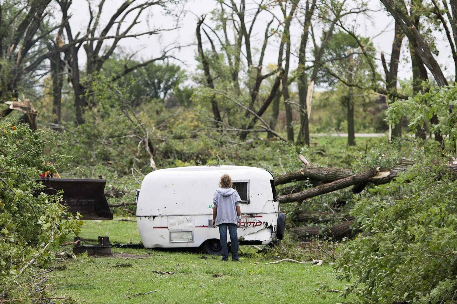 Jim Stoddard watches as his travel trailer is pulled from a ditch at the Wagon Train Lake campground on Friday in Hickman, Neb. (Ted Kirk / The Associated Press)