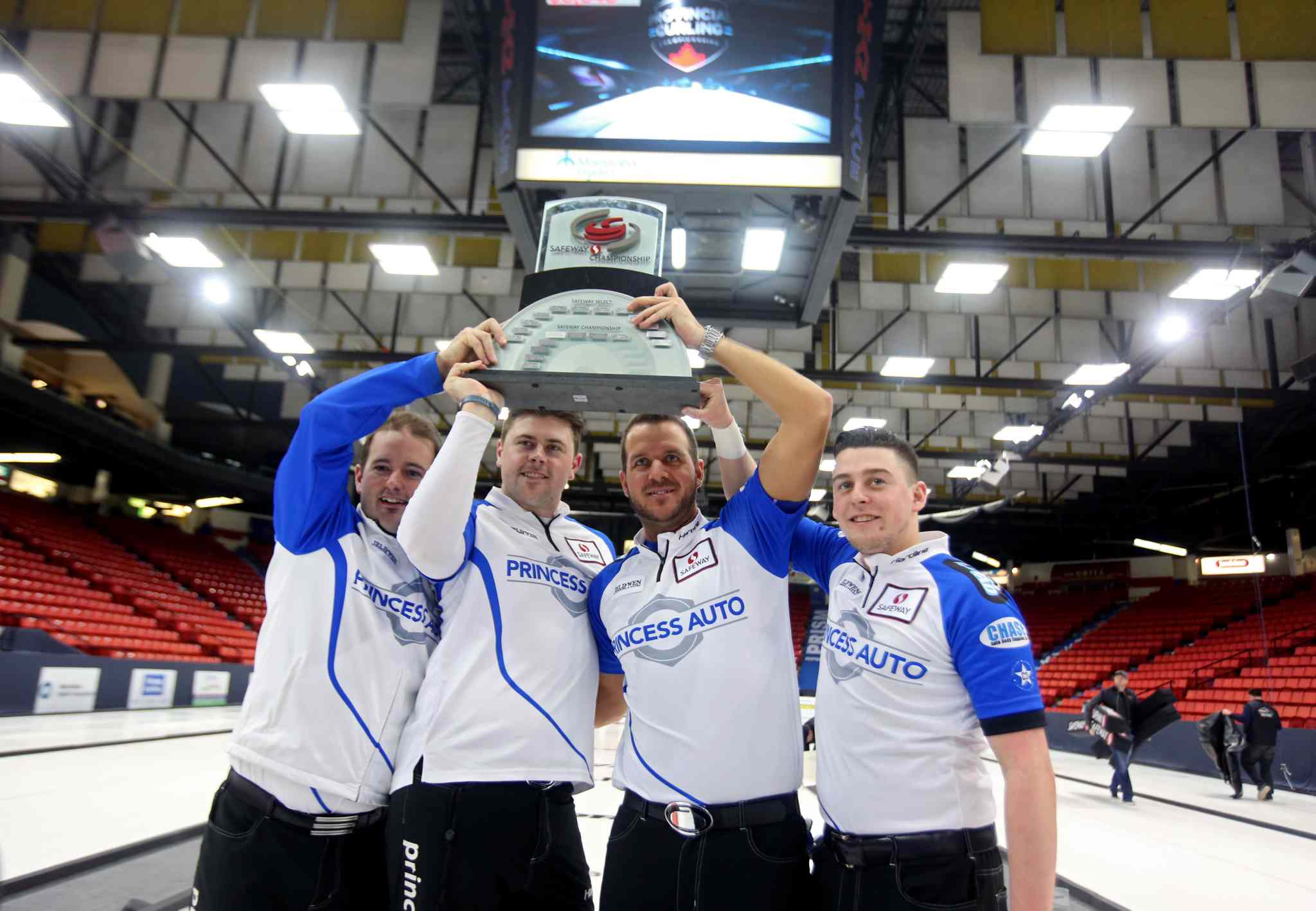 Skip Reid Carruthers, Braeden Moskowy, Derek Samagalski and Colin Hodgson (from left) pose with the Safeway Championship trophy after defeating Mike McEwen's rink to win the Safeway Championship provincial men's curling final at Westman Place in Brandon Sunday afternoon.