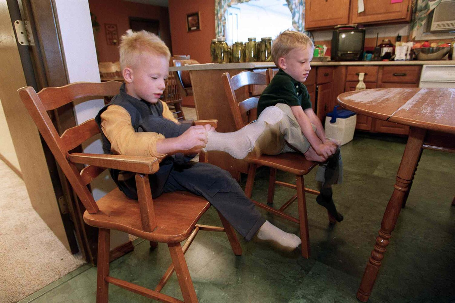 Sitting at the breakfast table, Myles, left, and Greg get dressed for their first day of kindergarten at R.J. Waugh Elementary School. (JEFF DE BOOY / WINNIPEG FREE PRESS FILES)