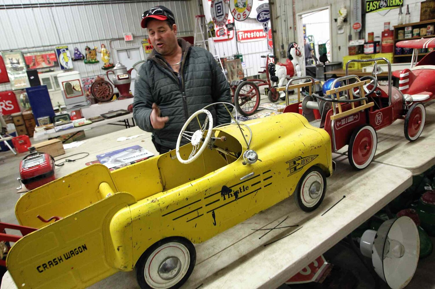 Auctioneer Stuart McSherry checks out the Thistle Crash Wagon, an old miniature car.