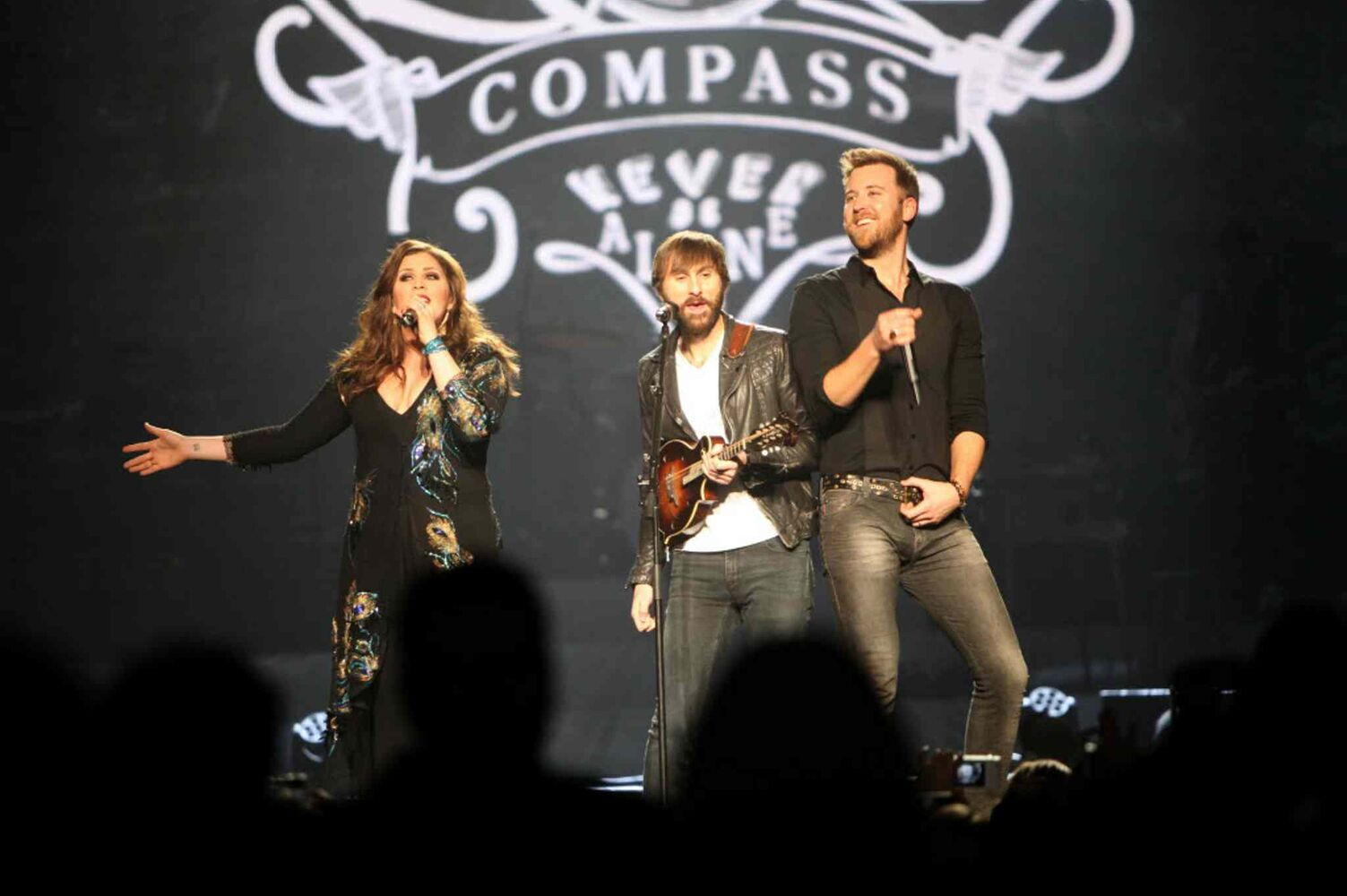 Lady Antebellum lead singers Charles Kelley and Hillary Scott sing with guitarist Dave Haywood.    (Ruth Bonneville / Winnipeg Free Press)
