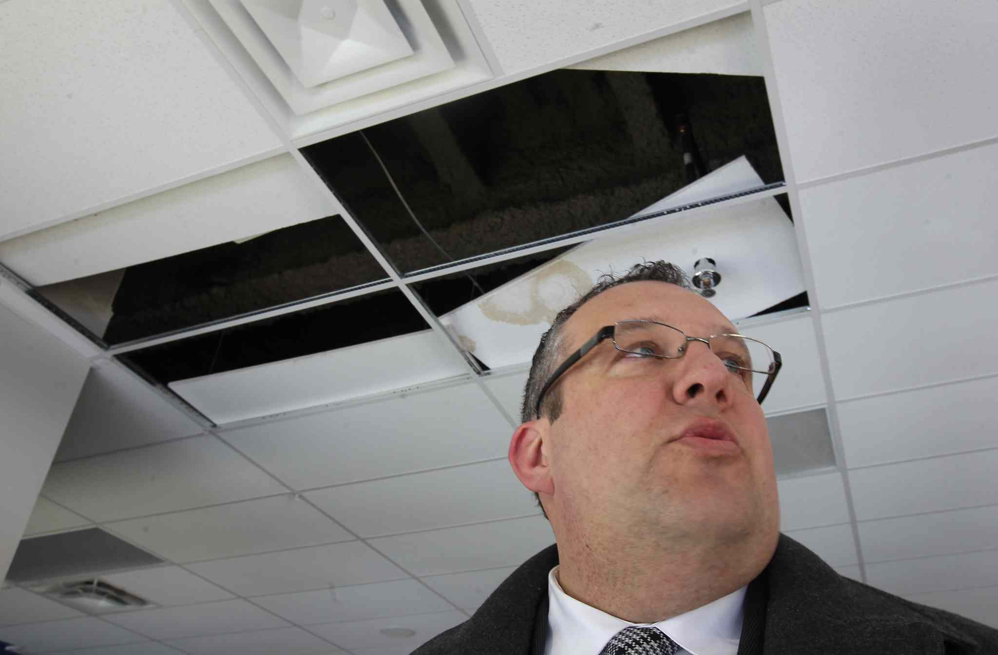Andrew Konowalchuk, chair of BBB Stadium Inc., announced that today the company will file a lawsuit  against architect and contractor for repairs required to the two-year-old Investors Group Field. Here he shows damaged tiles in a luxury suite.