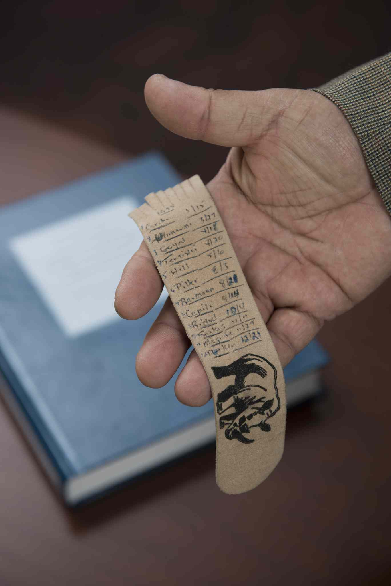 Murray Sinclair, the judge of the Pediatric Cardiac Inquest, with the inquest report and a bookmark that he made naming each of the 12 children whose deaths led to the inquest.