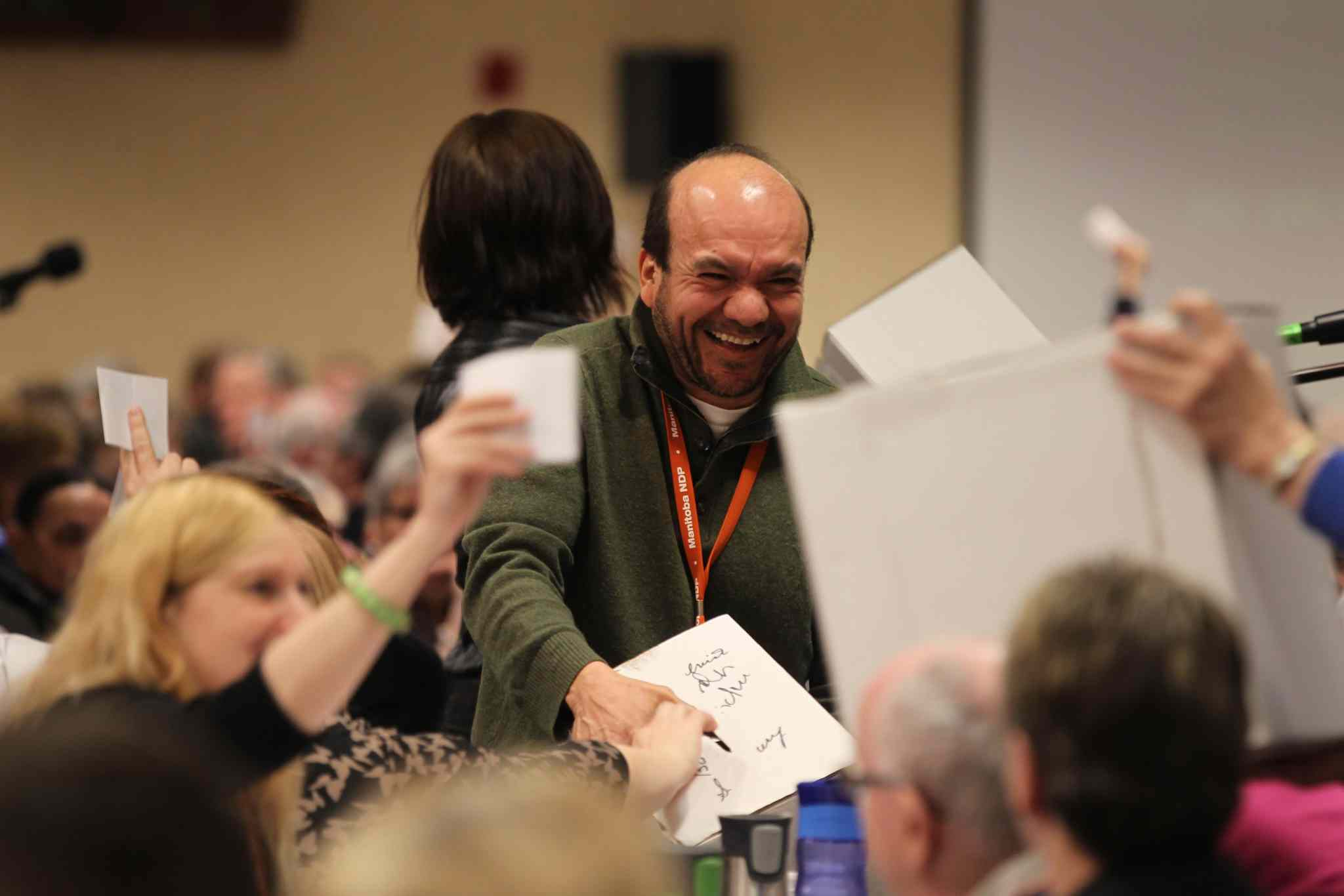 Felix Meza, an usher at the NDP Convention holds a ballet box for NDP members to cast their vote for president at the party convention on Saturday held at Canad Inns Polo Park. Saturday,  March 07, 2015 Ruth Bonneville / Winnipeg Free Press.