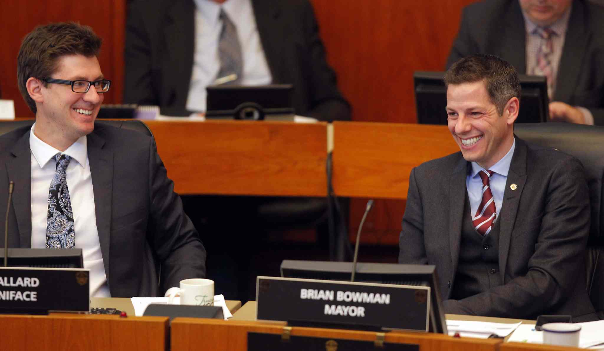 Coun. Matt Allard and Mayor Brian Bowman seem to be having a good time as the 2015 operating and capital budgets are passed Monday.