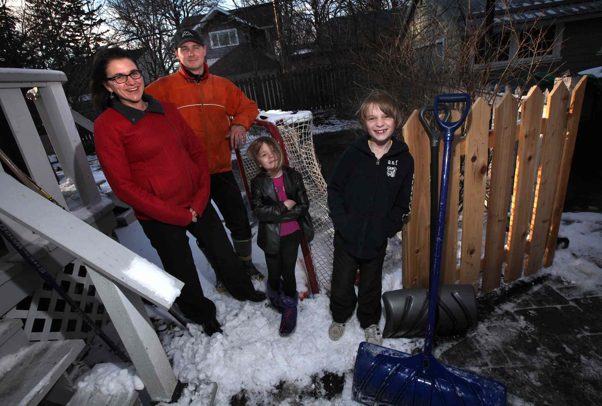 Kristen Pachet (from left), her husband Joel Savard, and their two children Thalia, 5, and Loic, 9, were teamed with refugees Gibril and Ann Marie Bangura and their 3 children (pictured at top).