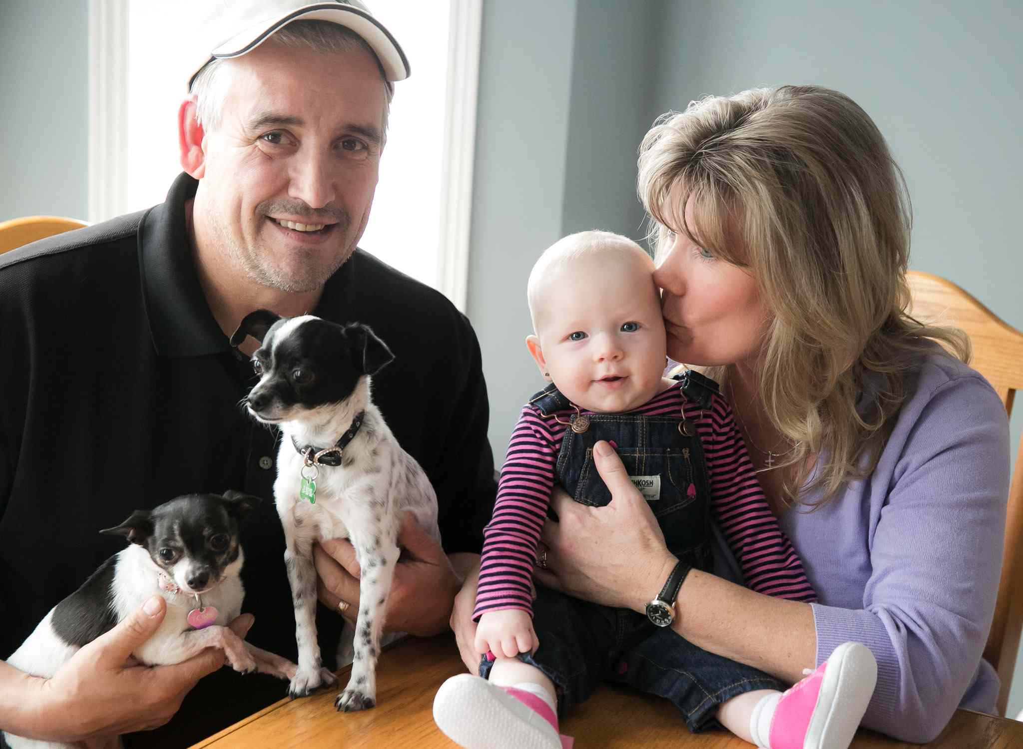 Glover with her husband Bruce, Shelly's six-month-old grandchild Mila and their two dogs. Glover announced April 3 that she would not seek re-election.