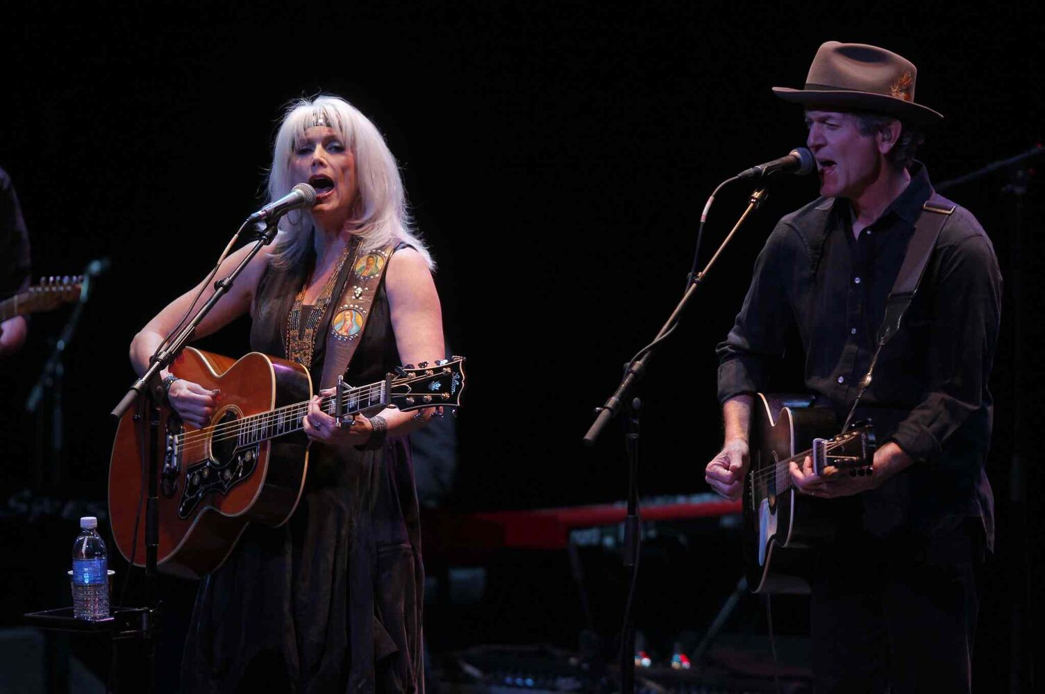 Singer-songwriters Emmylou Harris (left) and Rodney Crowell perform at the Burton Cummings Theatre Thursday night. (BORIS MINKEVICH / WINNIPEG FREE PRESS)