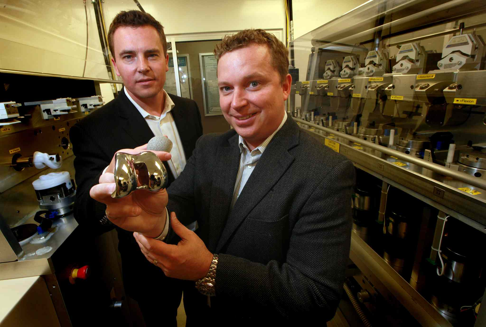 Dale Kellington (left) and Martin Petrak of the Orthopaedic Innovation Centre hold parts of a knee joint they will soon be printing in 3D. The firm is contributing to the boost in economic growth this year.