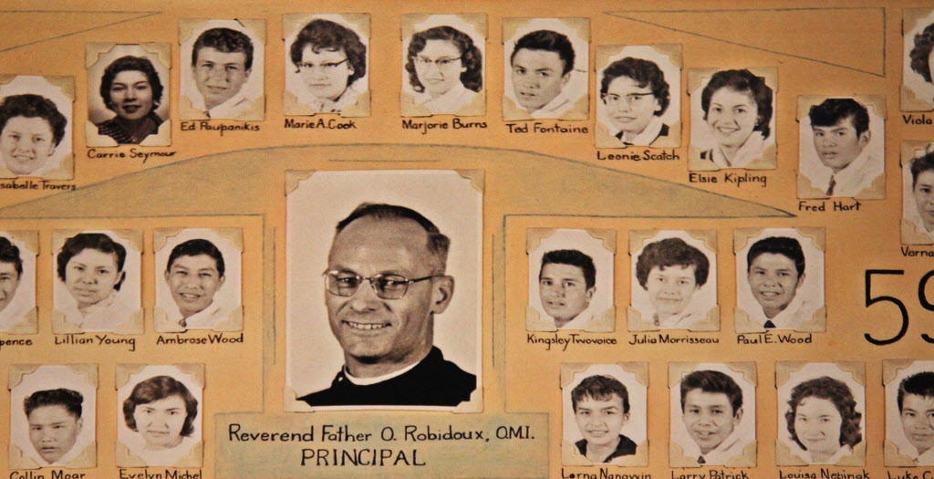 A class photo from 1958 shows school director Father Omer Robidoux with his students, including Fontaine, sixth from left in the top row.