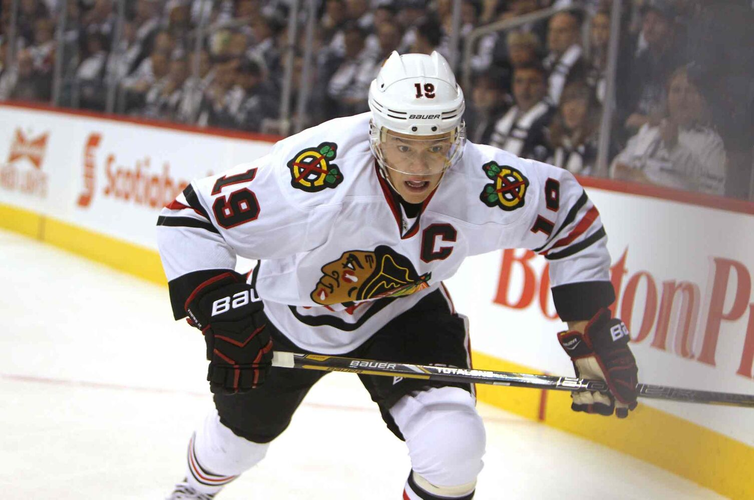 Jonathan Toews rushes down the boards during Saturday afternoons game. (Ruth Bonneville / Winnipeg Free Press)